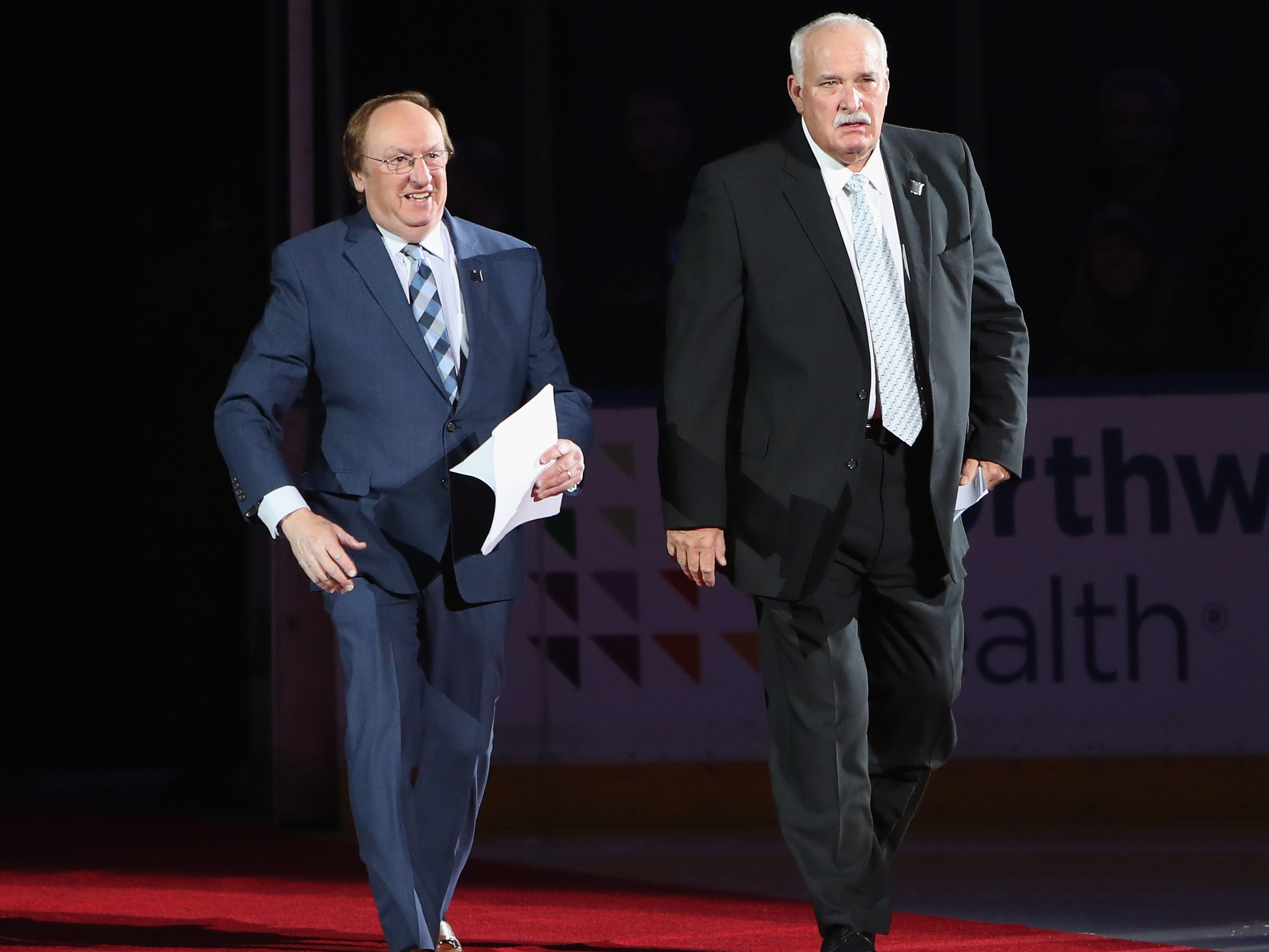 NEW YORK, NEW YORK - FEBRUARY 08: (l-r) Sam Rosen and John Davidson arrive to MC the ceremony for the New York Rangers 1994 Cup winning team prior to the Rangers game against the Carolina Hurricanes at Madison Square Garden on February 08, 2019 in New York City. The Rangers were celebrating the 25th anniversary of their Stanley Cup win in 1994.