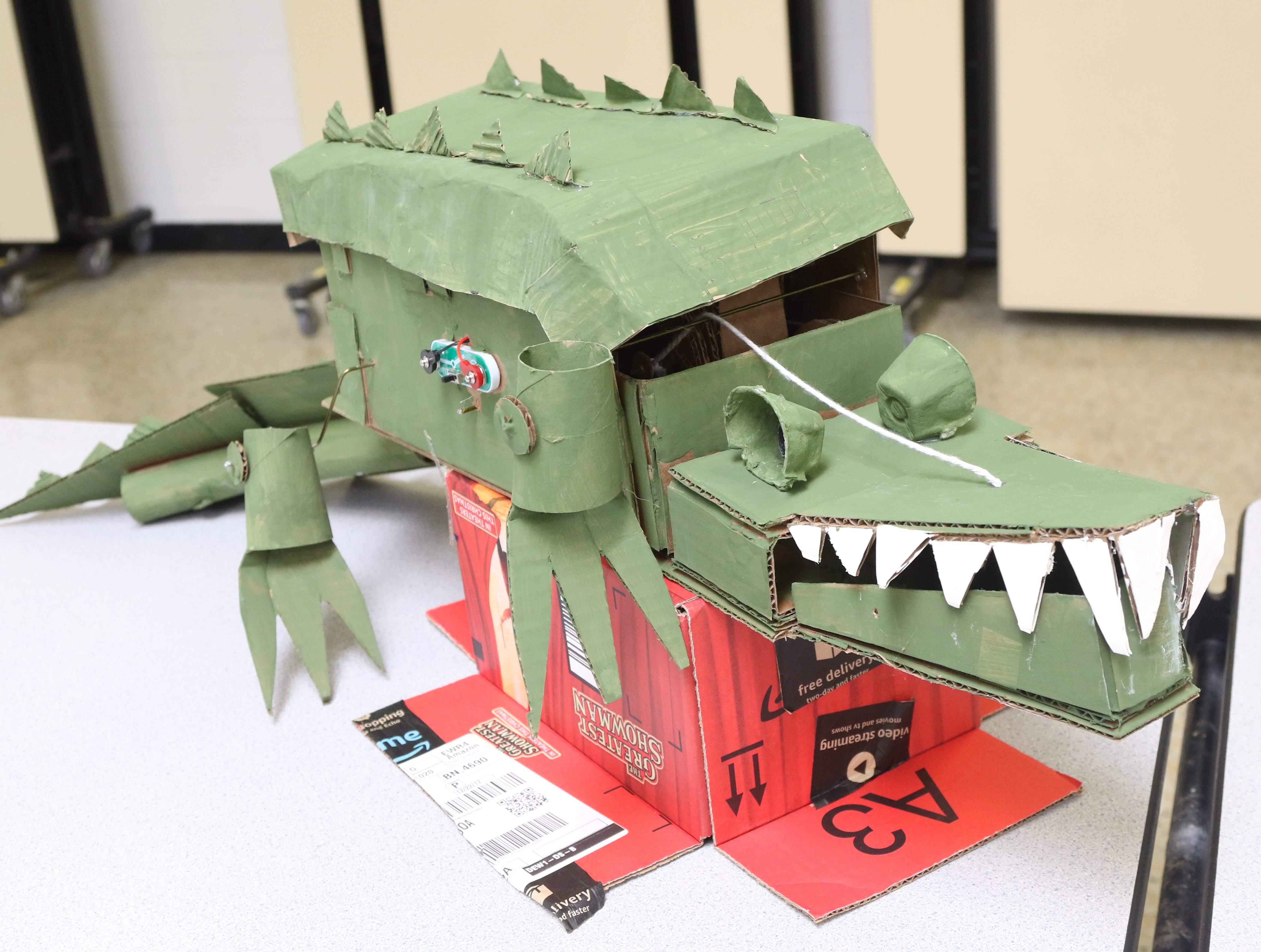 A cardboard alligator is part of the Cardboard Animal-a-thon at Ramapo HS where engineering students work on and display their projects, making mechanical animals out of cardboard. They also helped younger students work on projects during the event held at Ramapo HS on February 9, 2019.