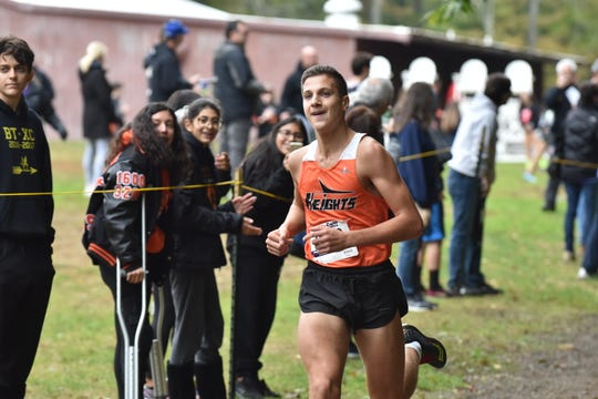 Hasbrouck Heights' Jeremy Bailey, during cross-country season, won the 800 and Hasbrouck Heights edged River Dell in an exciting distance medley relay at the  Lou Molino Memorial Invitational at the Rothman Center at Fairleigh Dickinson University on Feb. 4.