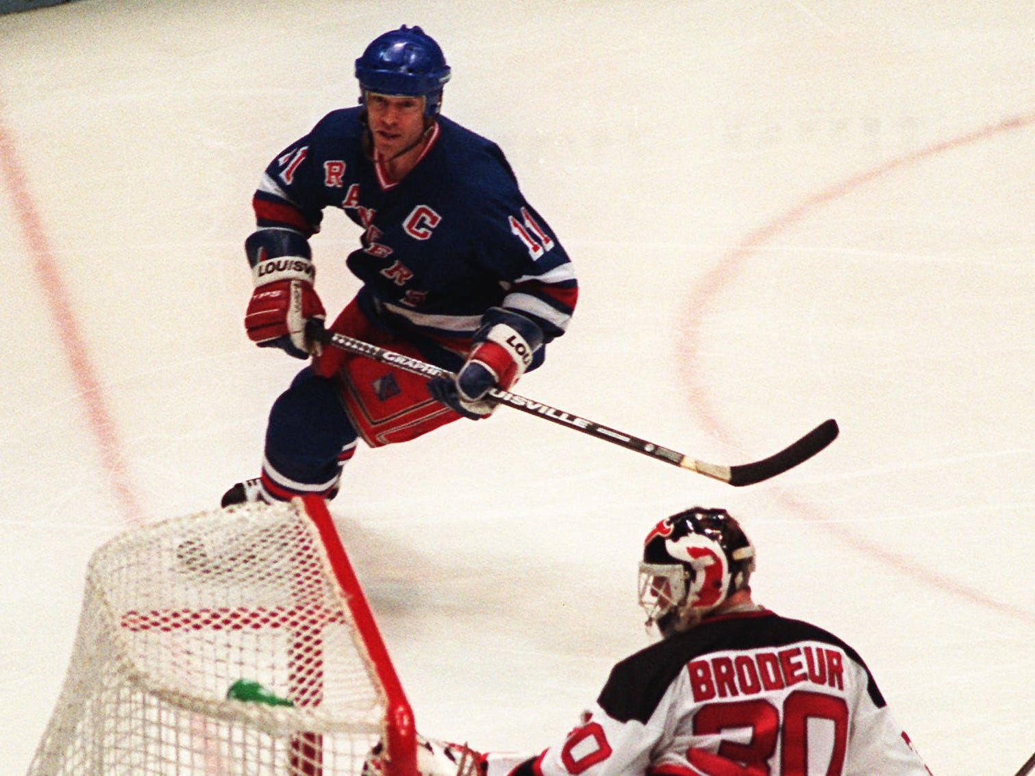 New York Rangers' Mark Messier puts the puck in the net past New Jersey Devils' goaltender Martin Brodeur (30) during the third period at Meadowlands Arena in East Rutherford, N.J., May 25, 1994. Messier scored three third period goals to give the Rangers a 4-2 win and to tie the Eastern Conference finals at three games a piece.