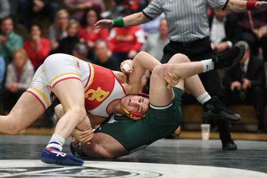 Bergen Catholic wrestling at Delbarton on Friday, February 8, 2019. (left) BC Chris Foca on his way to defeating D Kieran Calvetti in their 182 pound match.