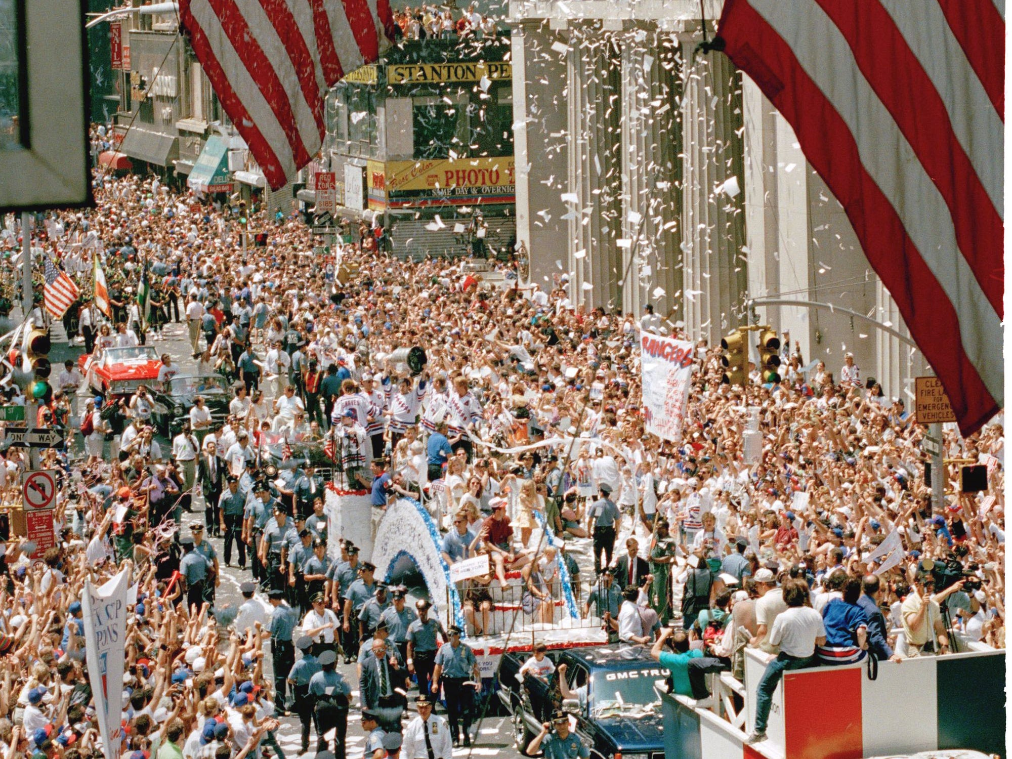 In a sea of ticker tape, fans gather along New York's famed Broadway to cheer the Stanley Cup winning New York Rangers during their victory parade Friday, June 17, 1994.