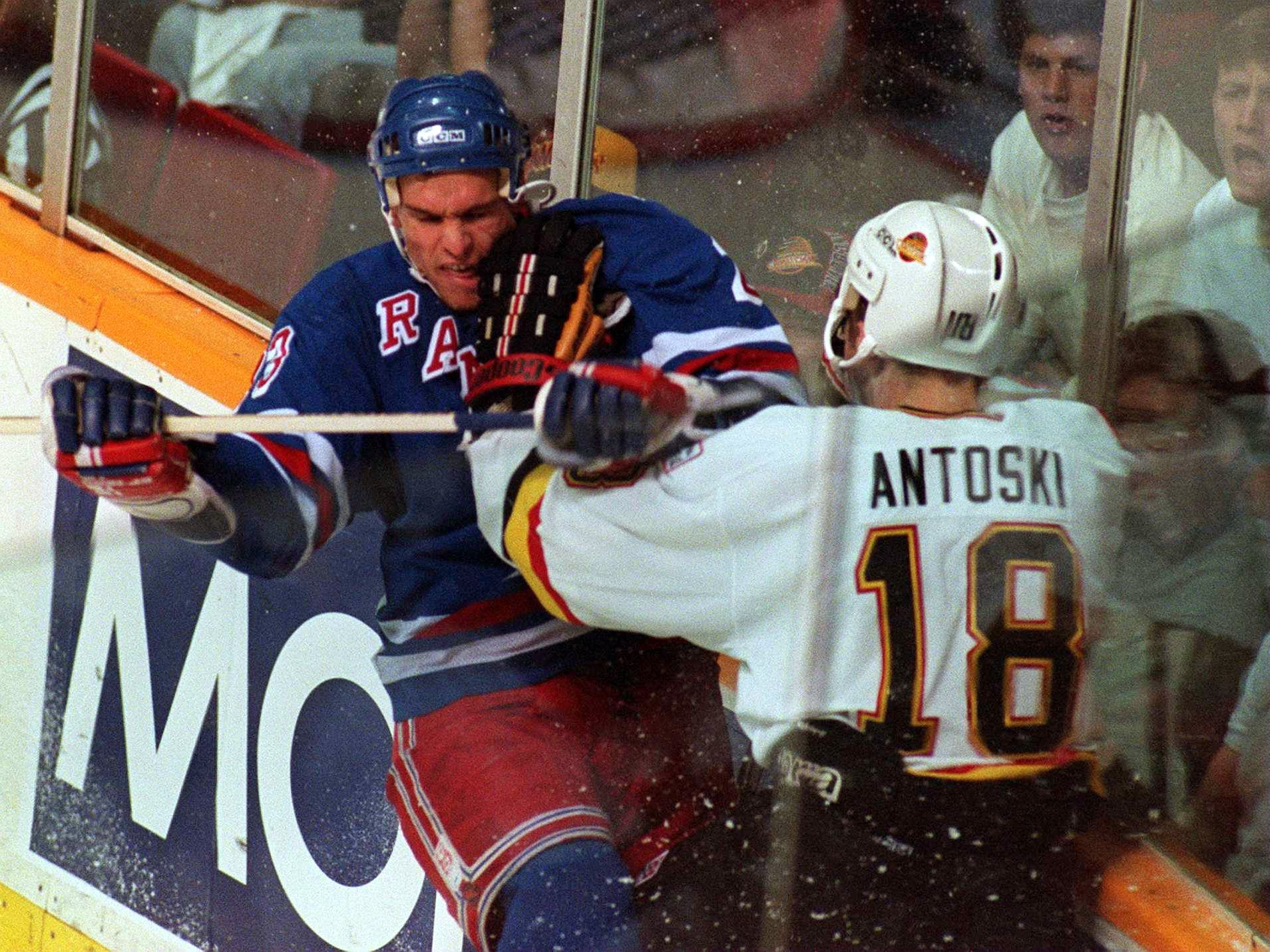11 Jun 1994: RANGER''S CENTER SERGEI NEMCHINOV AND THE CANUCK''S SHAWN ANTOSKI BATTLE AGAINST THE BOARDS DURING THE FIRST PERIOD OF GAME SIX OF THE STANLEY CUP FINALS IN VANCOUVER, BRITISH COLUMBIA.