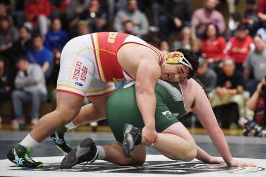 Bergen Catholic wrestling at Delbarton on Friday, February 8, 2019. (top) BC John High on his way to defeating D Liam Gray in their 285 pound match.