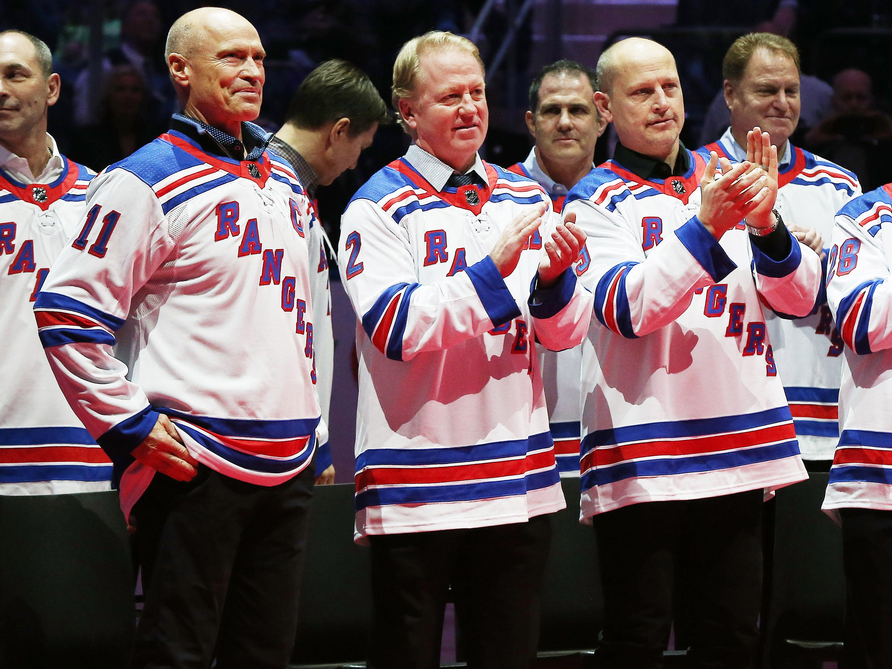 Feb 8, 2019; New York, NY, USA; Former New York Rangers captain Mark Messier associate catains Brian Leetch and Adam Graves look on during the ceremony honoring the 1994 Stanley Cup Championship New York Rangers team at Madison Square Garden.