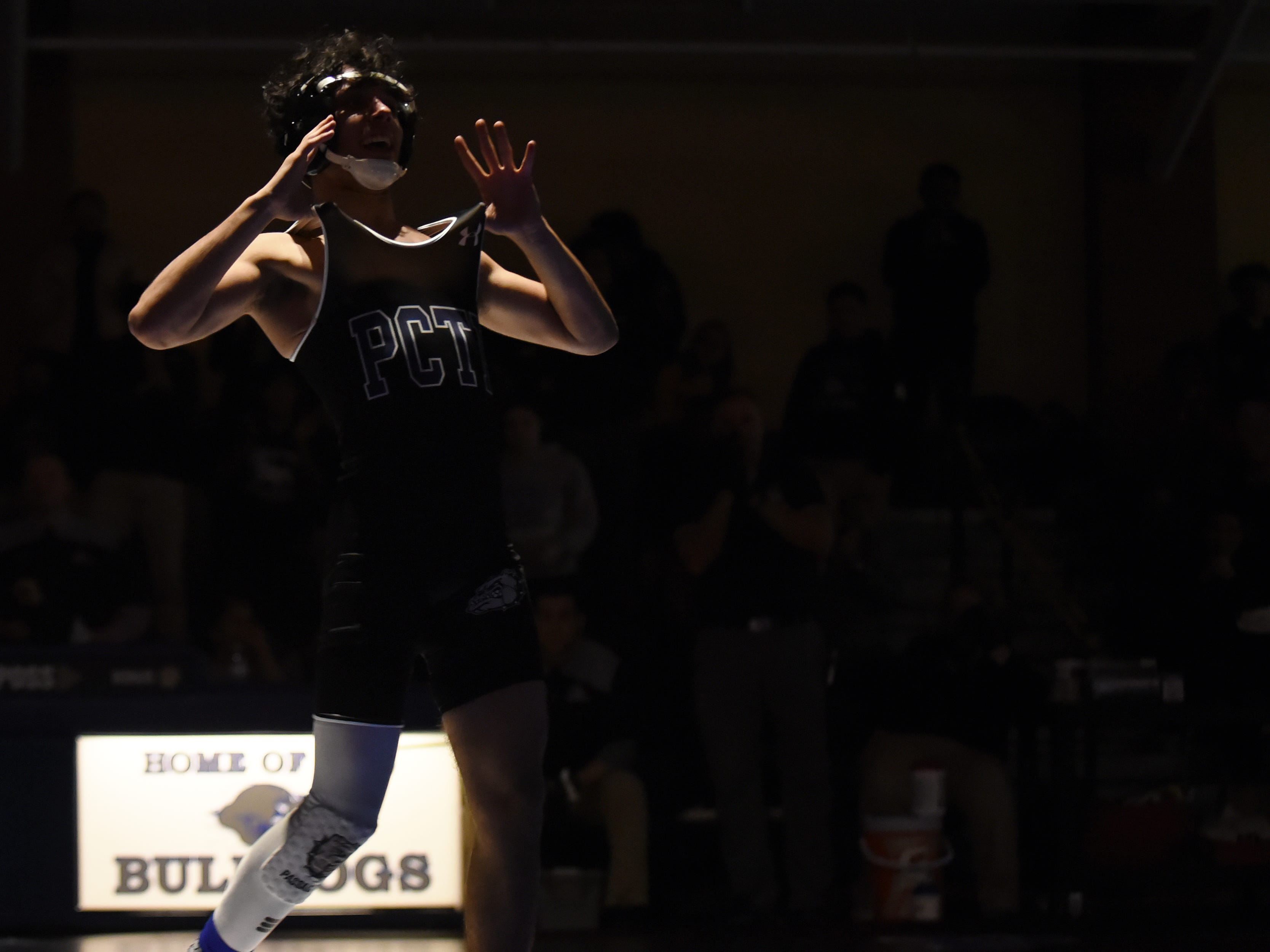 Passaic County Technical Institute wrestles Livingston High School for the North 1, Group 5 section championship at PCTI in Wayne on Friday February 8, 2019. At 126 pounds Mohammad Abu-Awad with PCTI celebrates beating Agostino Petrillo with LHS.