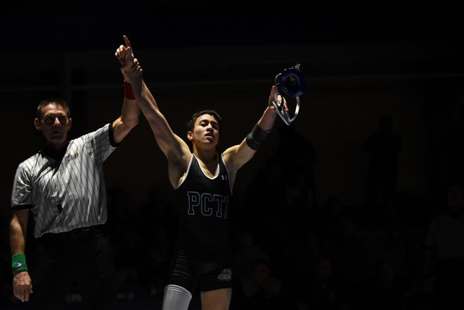 Passaic County Technical Institute wrestles Livingston High School for the North 1, Group 5 section championship at PCTI in Wayne on Friday February 8, 2019. At 113 pounds Laith Hamdeh with PCTI wins the match against Sean Neary with LHS.