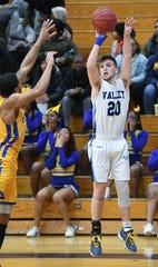 Taylor Jackson (20) and Wayne Valley defeated Paterson Charter in the quarterfinals of the 49th Passaic County boys basketball tournament.