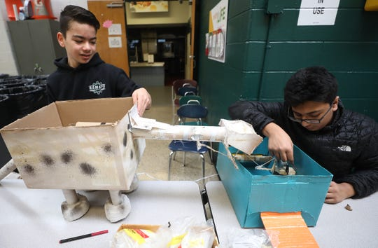 Freshman, Will Walloga and Mahad Rana work in the repair section to fix some of the contestant's projects as part of the Cardboard Animal-a-thon at Ramapo HS where engineering students work on and display their projects, making mechanical animals out of cardboard. They also helped younger students work on projects during the event held at Ramapo HS on February 9, 2019.