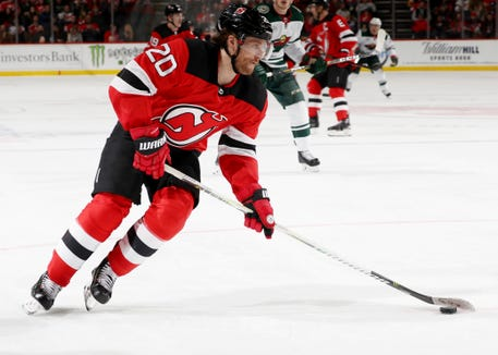 NEWARK, NEW JERSEY - FEBRUARY 09:  Blake Coleman (20) of the New Jersey Devils moving the puck against the Minnesota Wild at Prudential Center on February 9, 2019 in Newark, New Jersey.