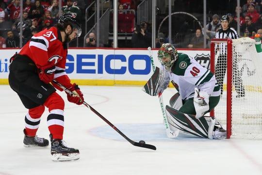 Feb 9, 2019; Newark, NJ, USA; Minnesota Wild goaltender Devan Dubnyk (40) makes a save against New Jersey Devils center Pavel Zacha (37) during the second period at Prudential Center.