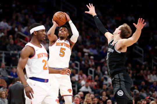Feb 8, 2019; Detroit, MI, USA; New York Knicks guard Dennis Smith Jr. (5) takes a shot against Detroit Pistons guard Luke Kennard (5) during the second quarter at Little Caesars Arena.