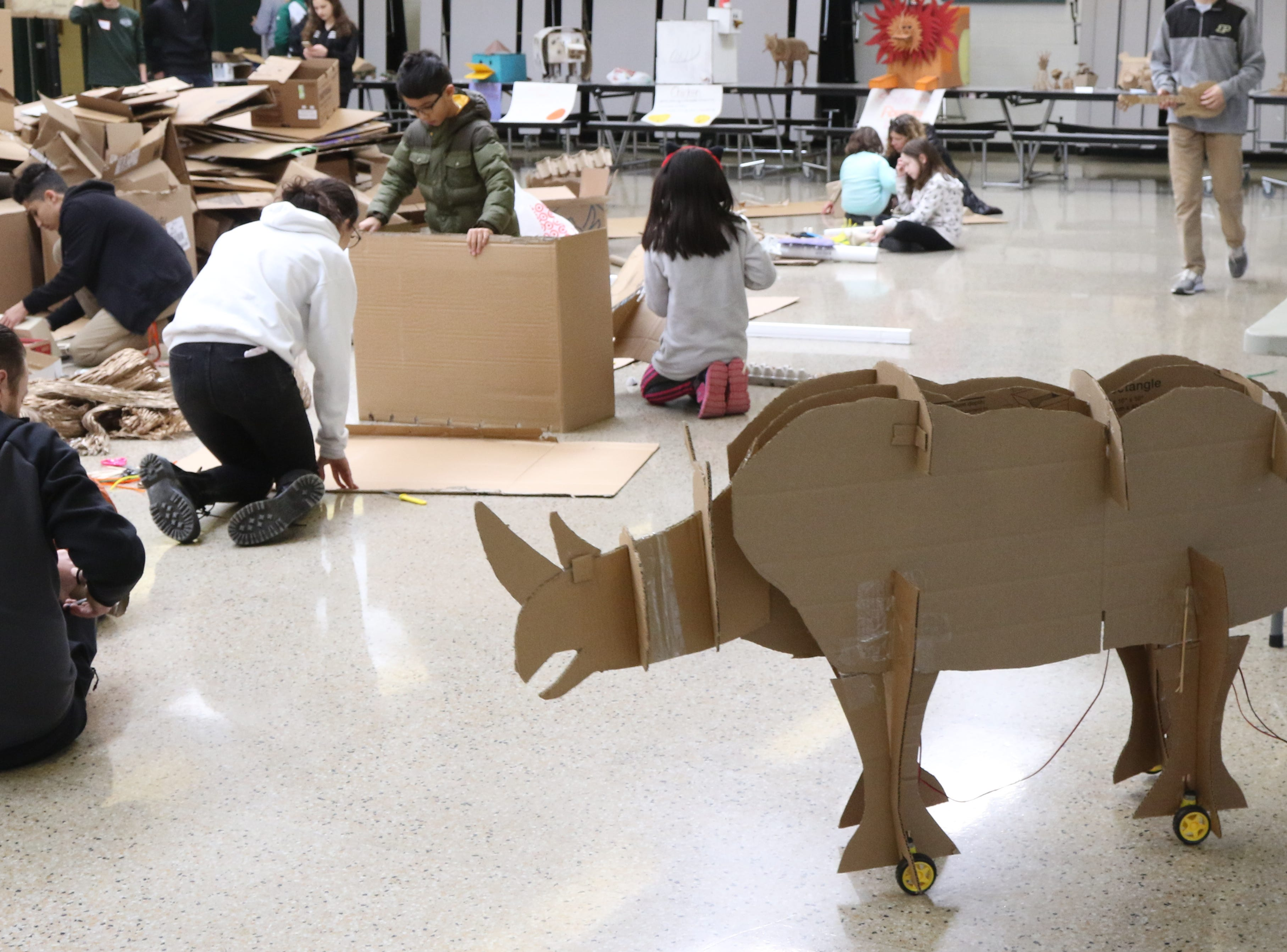A mechanical rhinoceros that has wheels is part of the Cardboard Animal-a-thon at Ramapo HS where engineering students work on and display their projects, making mechanical animals out of cardboard. They also helped younger students work on projects during the event held at Ramapo HS on February 9, 2019.