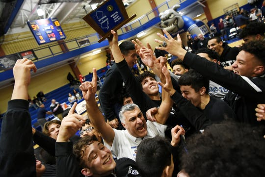 Passaic County Technical Institute celebrates a win against Livingston High School for the North 1, Group 5 section championship at PCTI in Wayne on Friday February 8, 2019.