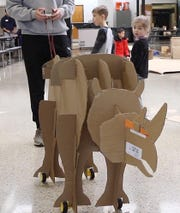 This walking rhinoceros is part of the Cardboard Animal-a-thon at Ramapo HS where engineering students work on and display their projects, making mechanical animals out of cardboard. They also helped younger students work on projects during the event held at Ramapo HS on February 9, 2019.