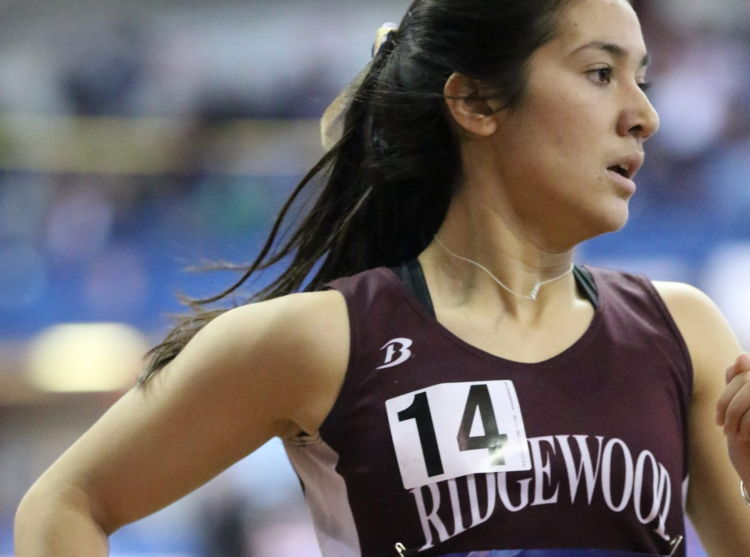 Katherine Muccio runs the second leg of the 4x800 meters for Ridgewood. Saturday, February 9, 2019