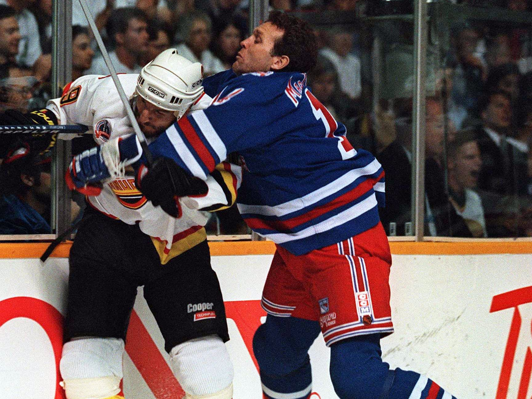 7 Jun 1994: RANGERS FORWARD CRAIG MACTAVISH PUTS A HIT ON THE CANUCK''S TIM HUNTER DURING GAME FOUR OF THE STANLEY CUP FINALS IN VANCOUVER, BRITISH COLUMBIA. THE RANGERS WON THE GAME, 4-2, AND HEAD BACK TO NEW YORK FOR GAME FIVE LEADING THE SERIES, 3-1.