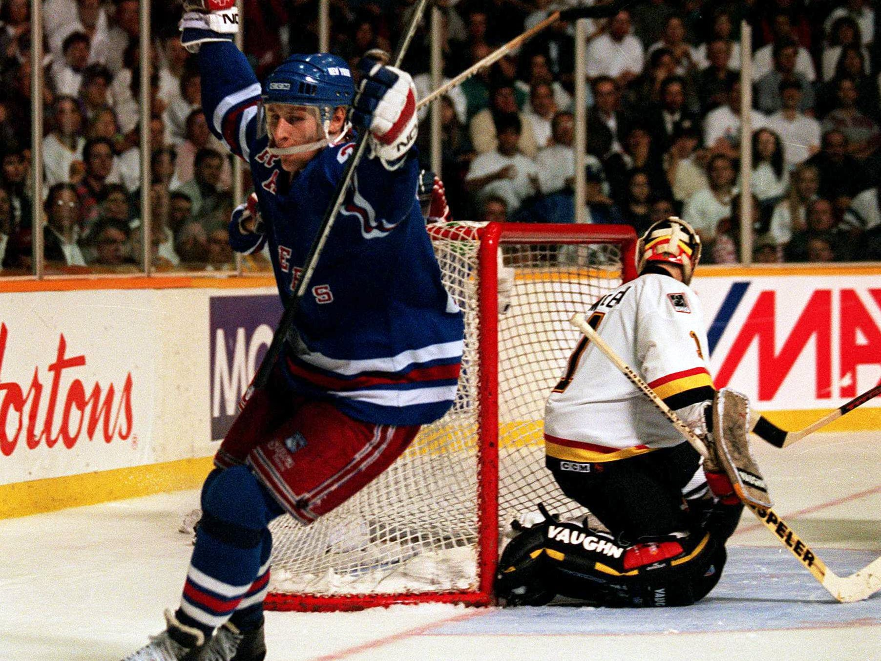 7 Jun 1994: RANGERS FORWARD ALEXEI KOVALEV CELEBRATES AFTER SCORING THE WINNING GOAL TONIGHT AGAINST CANUCKS GOALTENDER KIRK MCLEAN DURING THE THIRD PERIOD OF GAME FOUR OF THE STANLEY CUP FINALS IN VANCOUVER, BRITISH COLUMBIA. THE RANGERS WENT ON TO WIN,