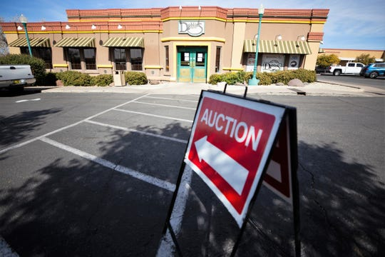 A red auction sign points to the now vacant Dublin's Pub building. The pub closed and its contents were auctioned off on February 9, 2019.