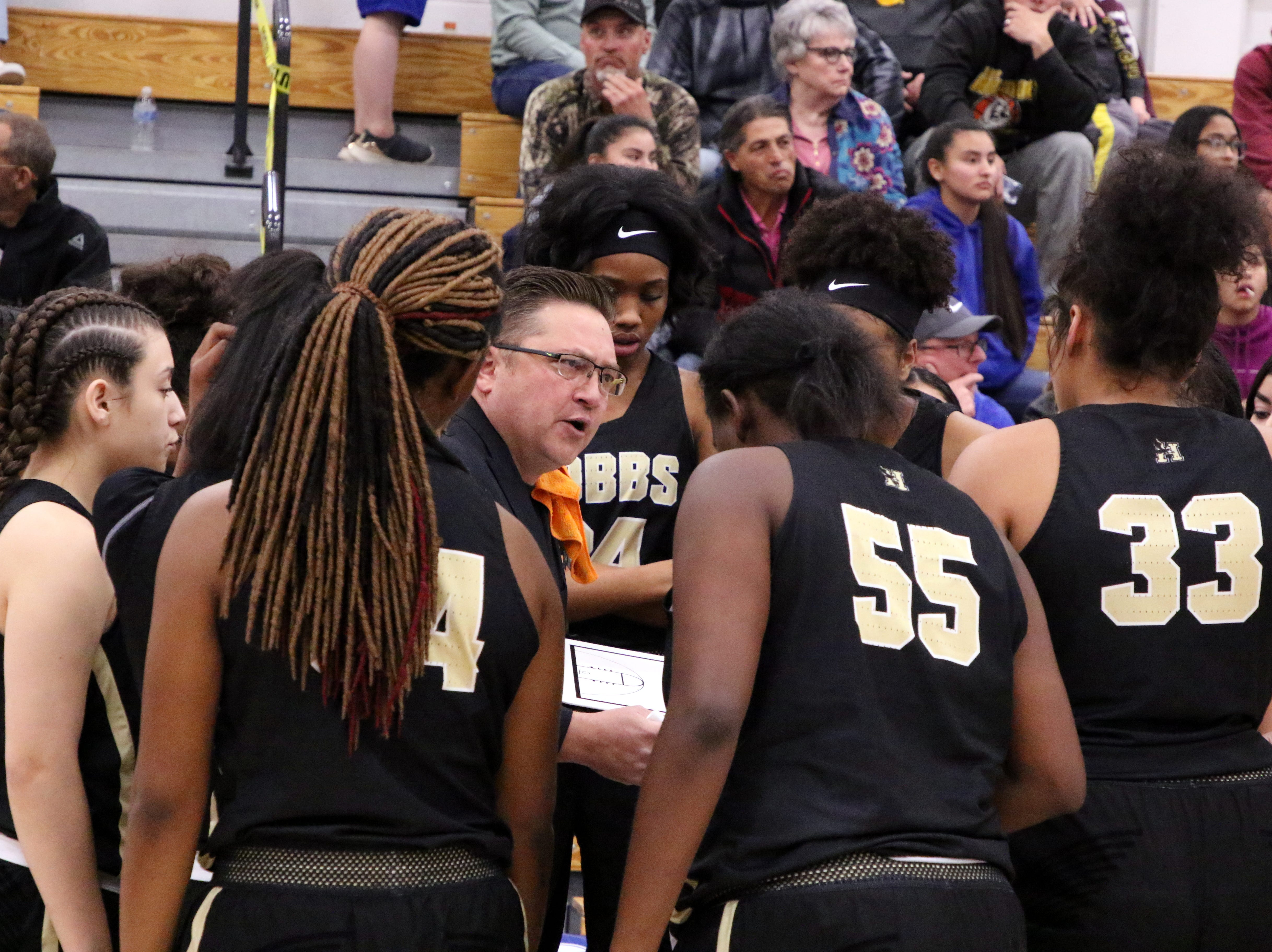 Hobbs coach Joe Carpenter talks to his team during a first half timeout in Friday's game against Carlsbad.