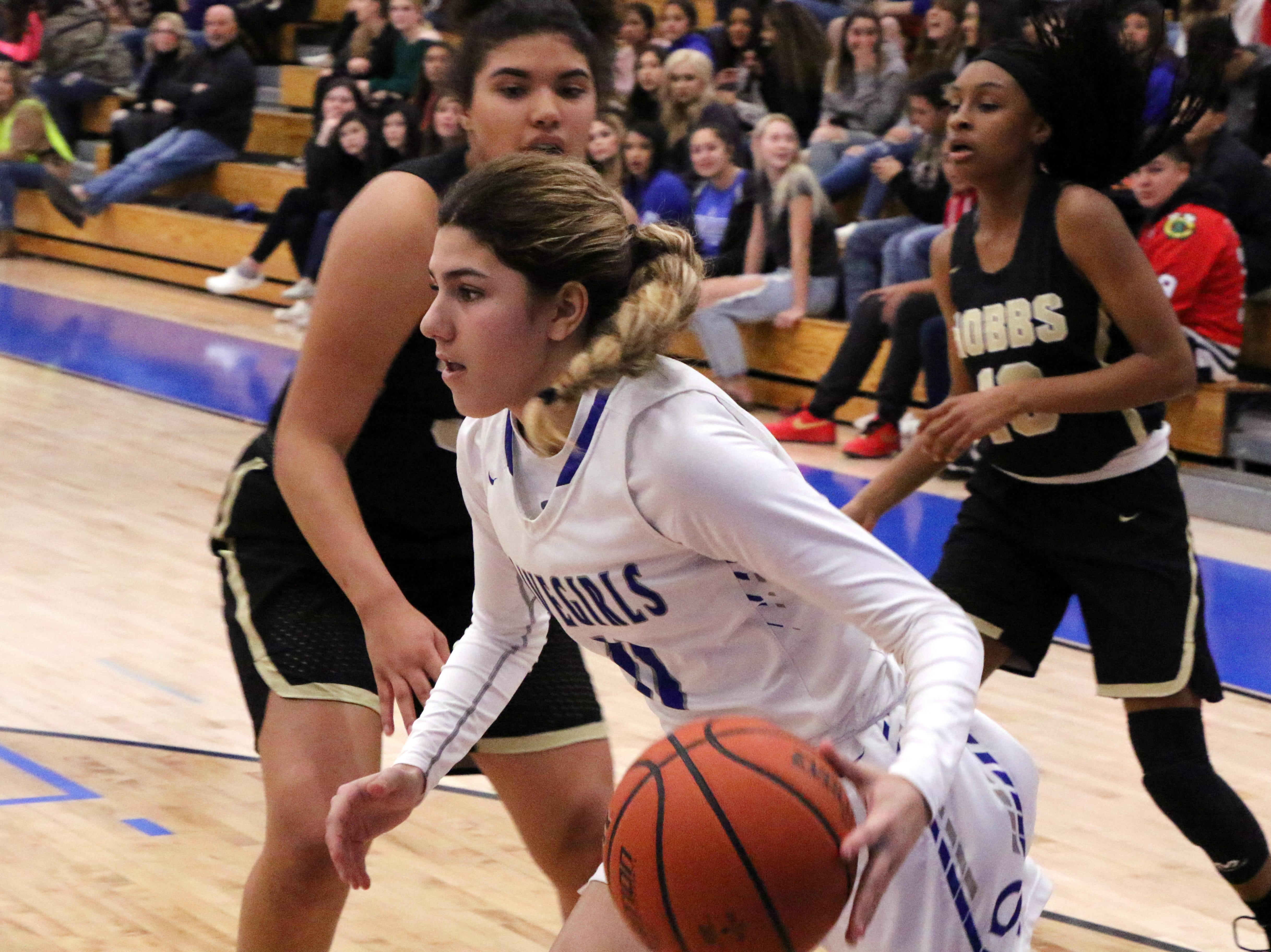 Carlsbad's Teran Tiller drives the lane during the first quarter of Friday's game against Hobbs. Hobbs won, 46-42.