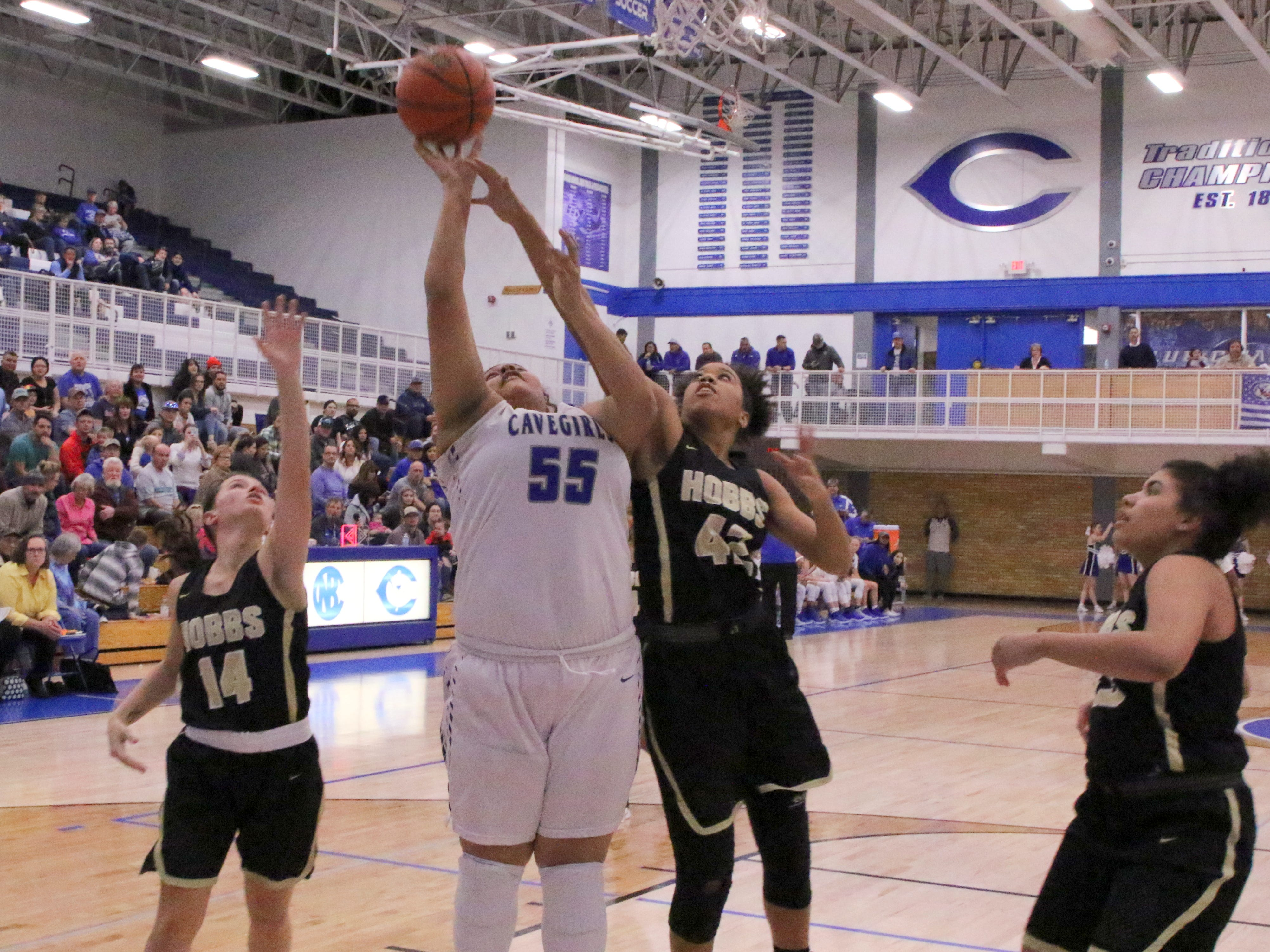 Carlsbad's Kaliyah Montoya (55) goes for a contested layup against Hobbs' Elise Turrubiates (42) during Friday's game. Montoya led all scorers with 17 points and Hobbs won, 46-42.