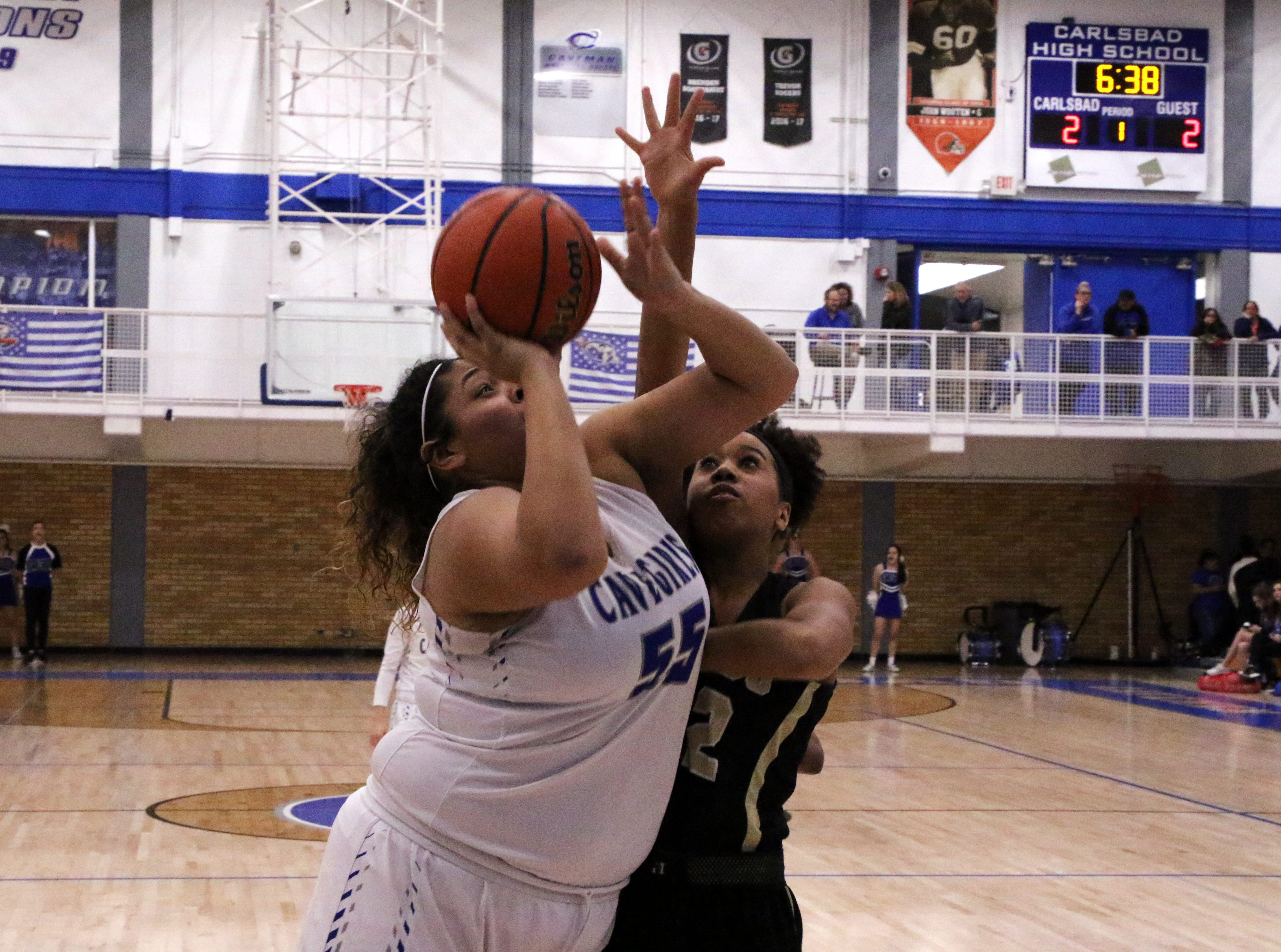 Carlsbad's Kaliyah Montoya goes for a contested shot against Hobbs' Elise Turrubiates during the first quarter of Friday's game. Montoya led all scorers with 17 points and Hobbs won, 46-42.