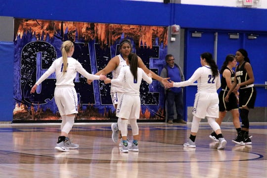 Kaliyah Montoya is congratulated by her three teammates after getting fouled as part of an and-one in the first half of Friday's game against Hobbs.
