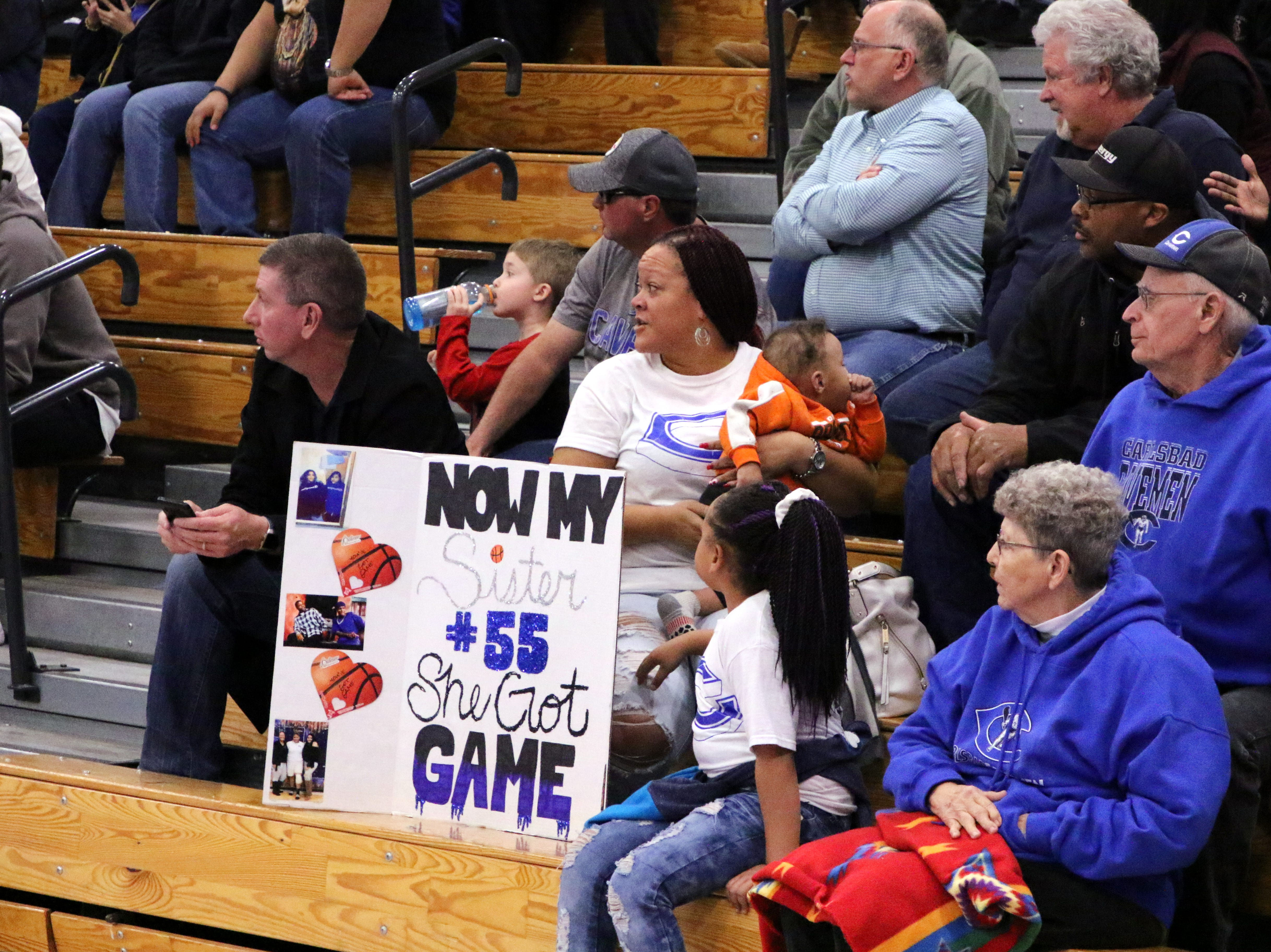 Kaliyah Montoya's family brought their sign to Friday's game. Montoya led all scorers with 17 points.