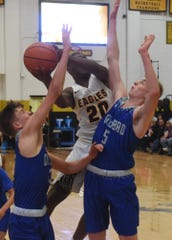 Evan Sullivan attempts to block a shot form Hobbs' Quintrel Van Hook during the second quarter of a District 4-5A basketball game in Tasker Arena Friday night. Carlsbad lost 85-70.