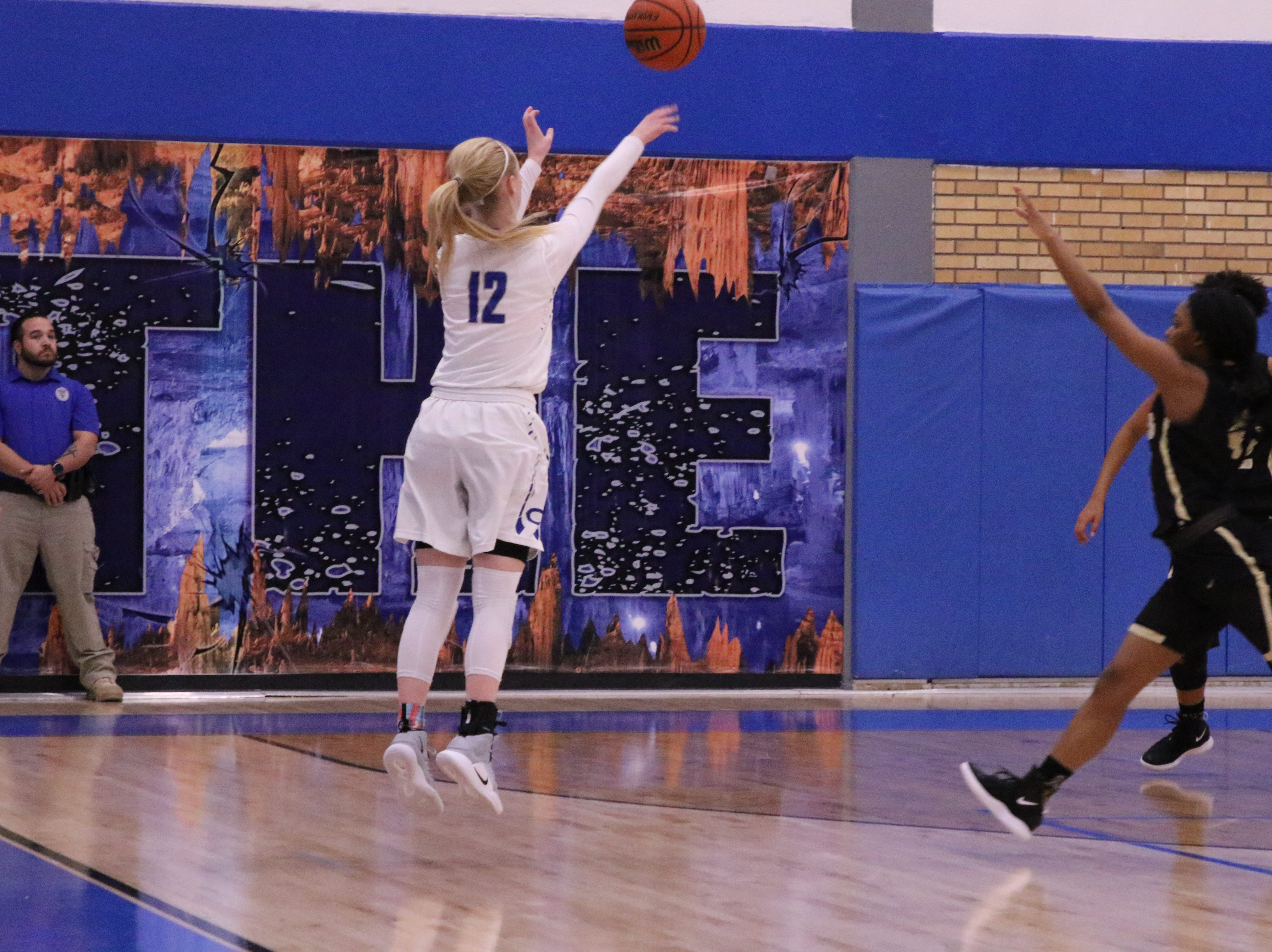 Carsyn Boswell takes an uncontested 3-point shot during Friday's game. She finished with 14 points.