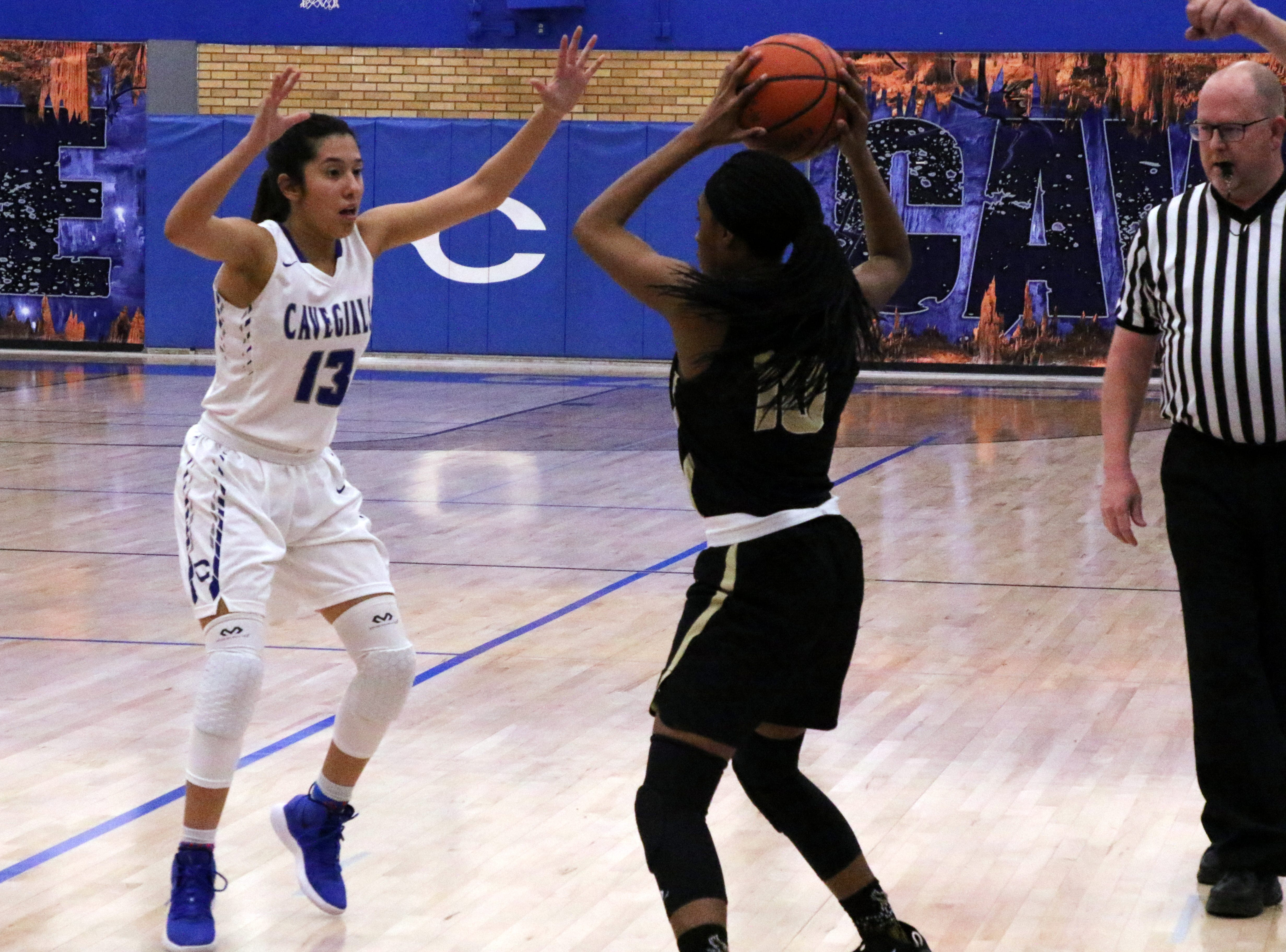 Carlsbad's Tori Flores guards Hobbs' Wisdom Anthony in the second half of Friday's game. Hobbs won, 46-42.