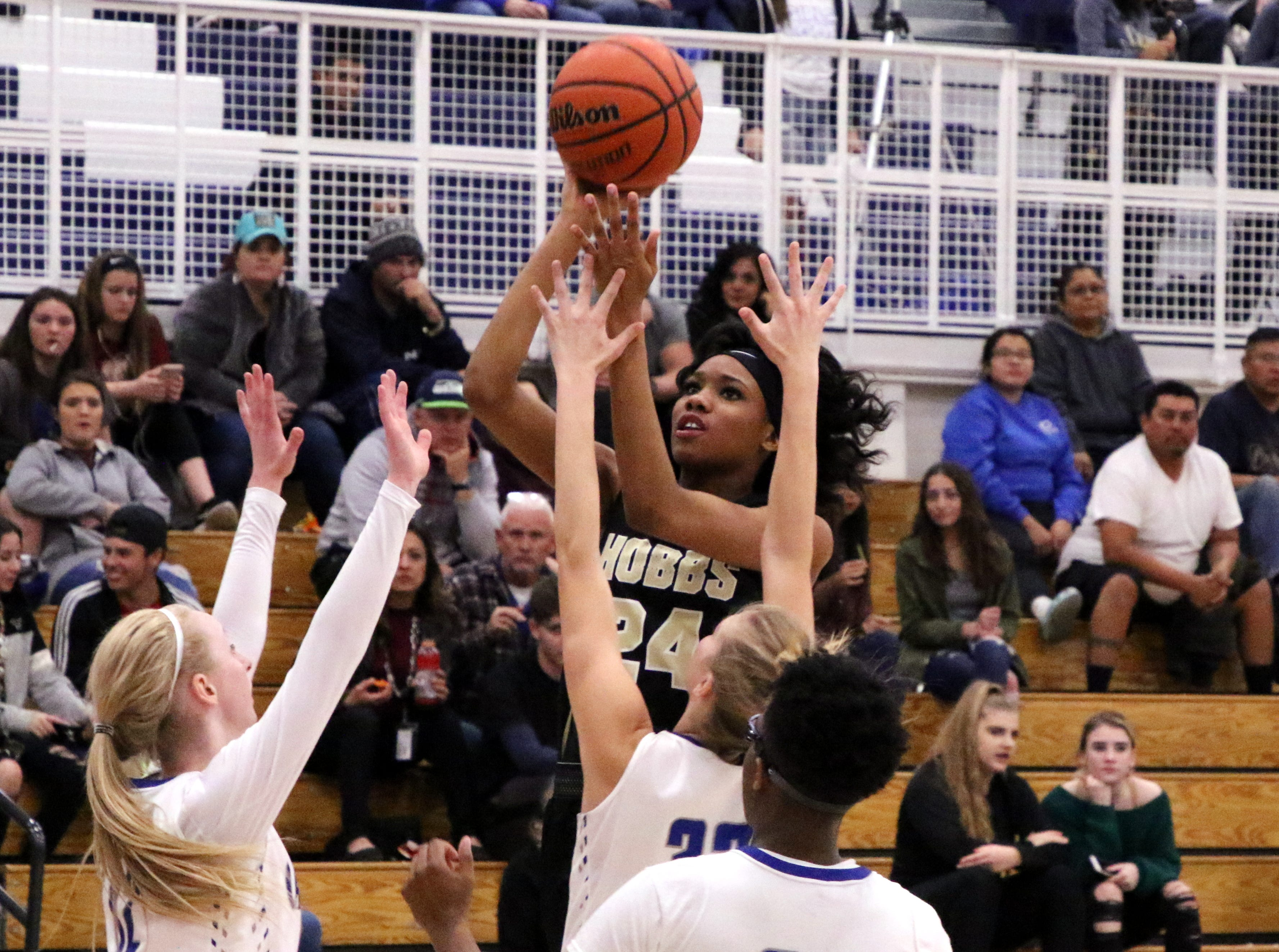 Ayanna Smith takes a shot over three Cavegirl defenders in the first half of Friday's game. Smith finished with 10 points for the Lady Eagles.