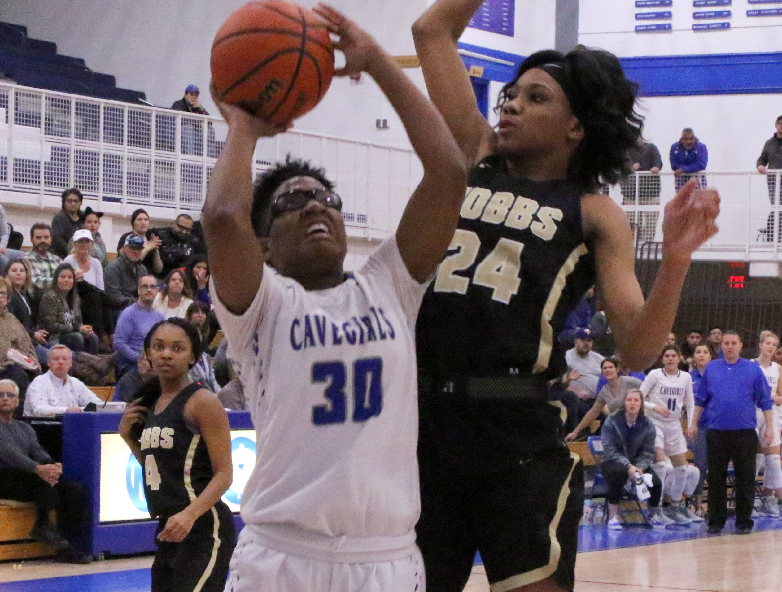 Carlsbad's Dayshaun Moore (30) goes for a layup while Hobbs' Ayanna Smith (24) goes for a block in Friday's game.