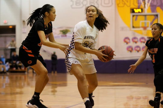 Kirtland Central's Siigrid Lii'bilnaghahi attacks the basket against Gallup's Cearra Williams during Friday's District 1-4A game at Bronco Arena.