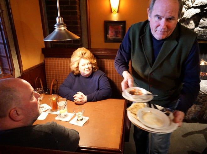 Stella's owner Bob Ostendorf is hands-on enough that he'll clear dishes and chat with longtime guests at his restaurants, as seen in this pre-pandemic file photo.