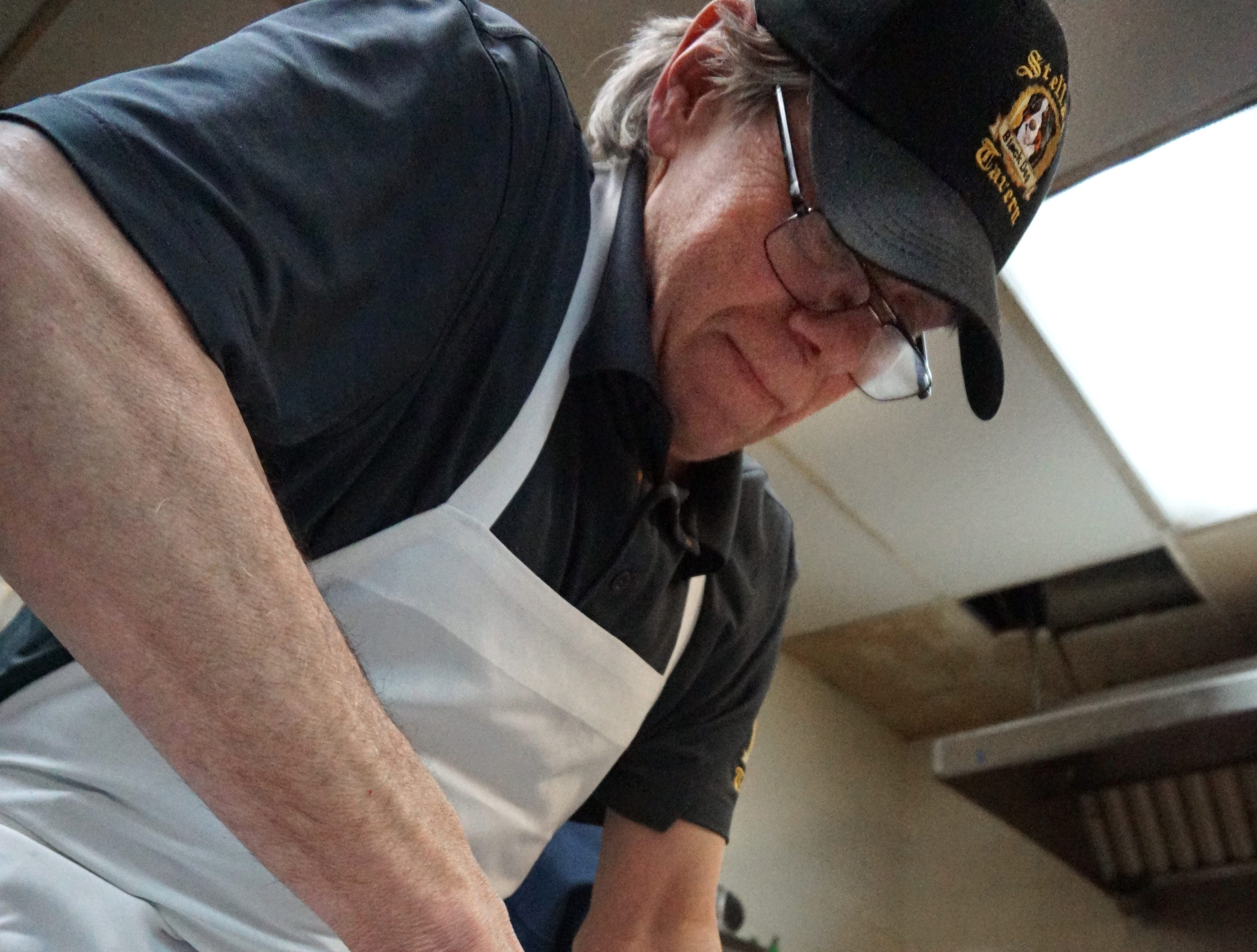Stella's executive chef Brian Doyle cracks open some Chesapeake blue points for the restaurant's signature Oysters Rockefeller.