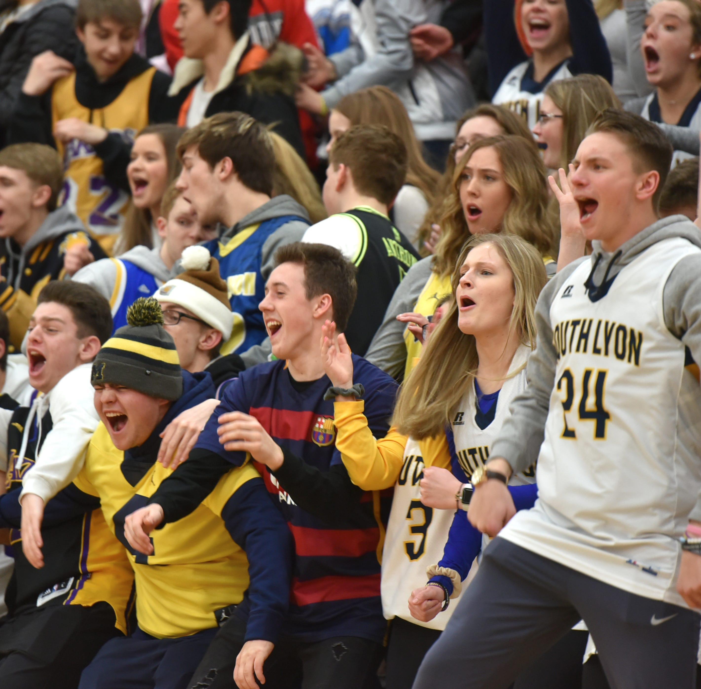 South Lyon student cheering sections add flavor to hoops rivalry