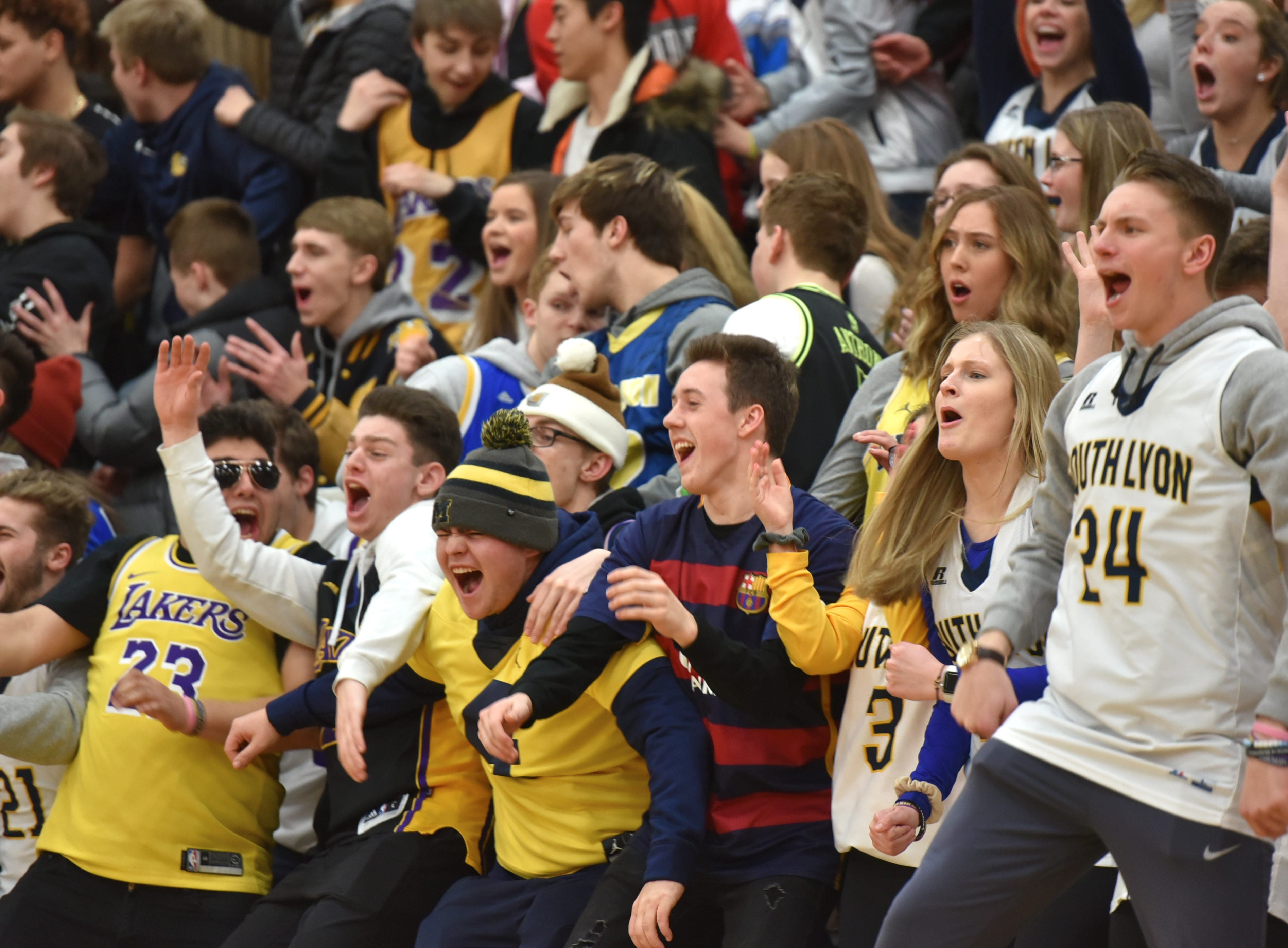 South Lyon High's student section reacts to a good play by their Lion team on Feb. 8.