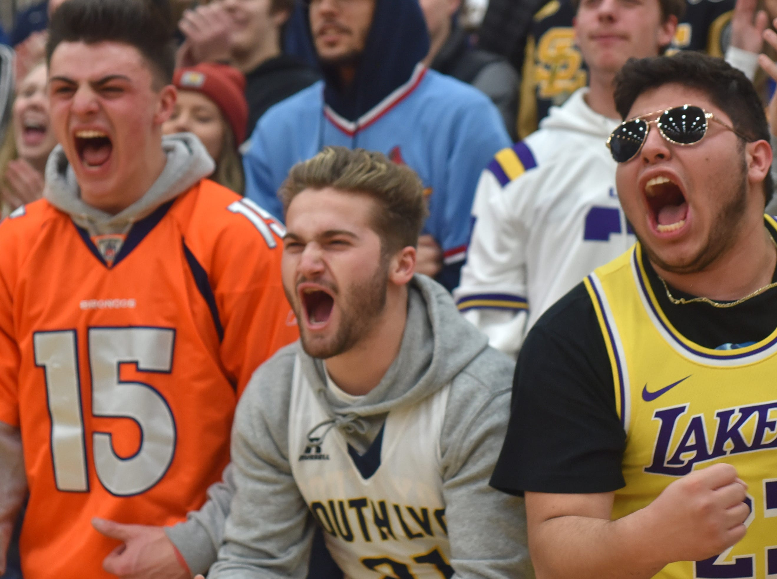 South Lyon students react to a basket by their team.