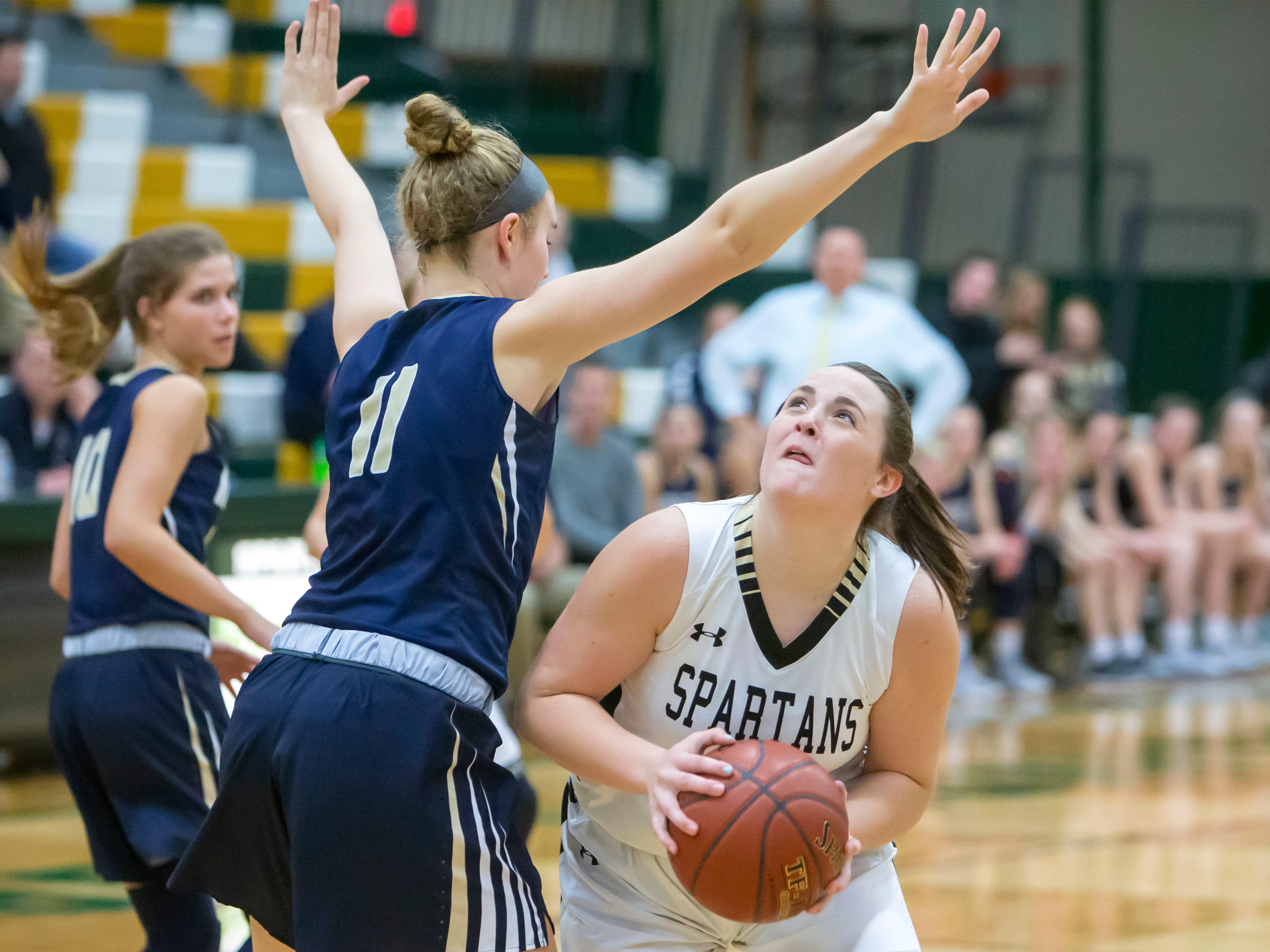 Oshkosh North's Brie Gauthier looks to shoot around Appleton North's Emma Erickson at the girls basketball game Friday, February 8, 2019, in Oshkosh, Wis., at Oshkosh North High School.