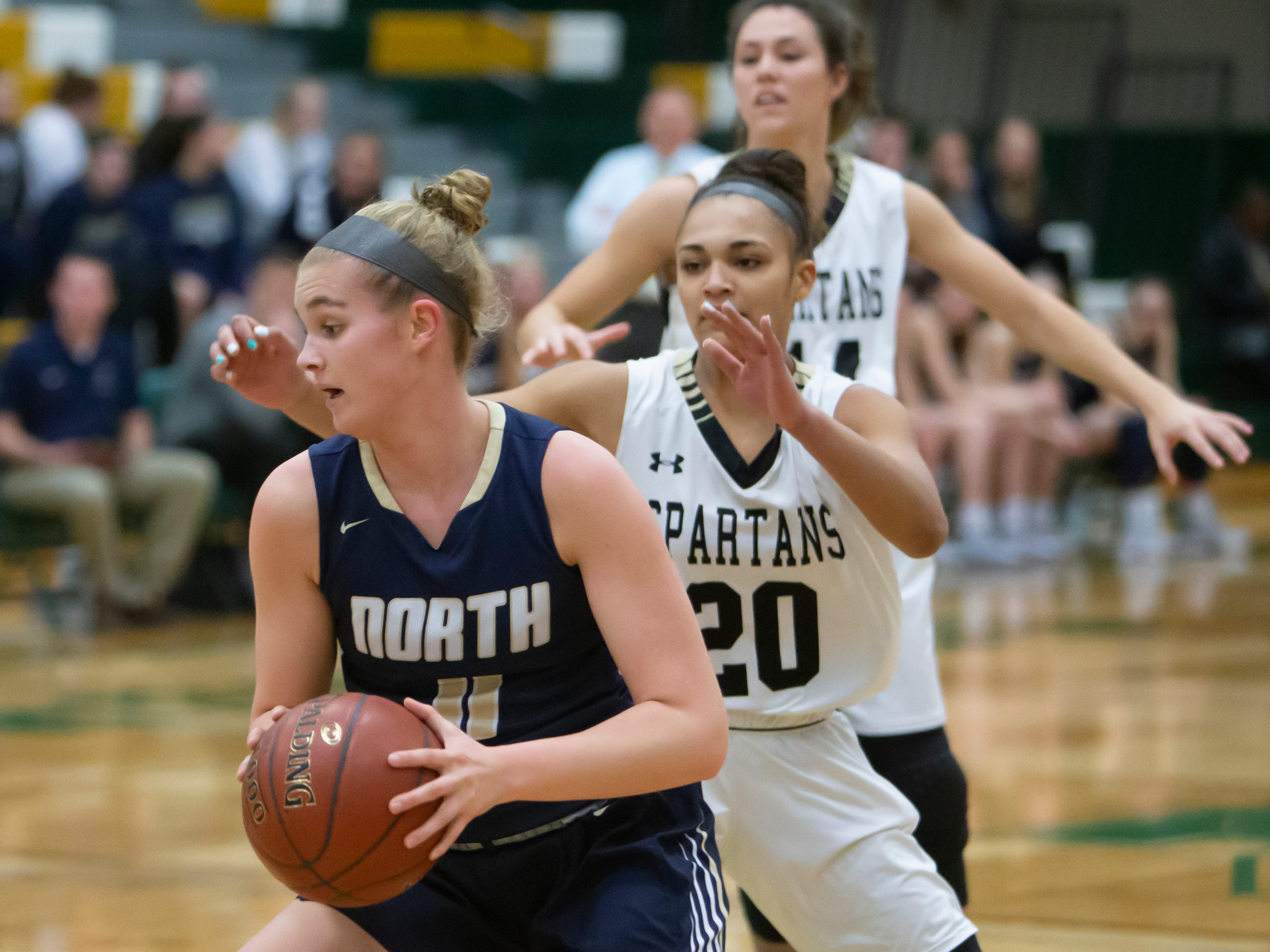 Appleton North's Emma Erickson looks for an opening to the basket playing against Oshkosh North during the girls basketball game Friday, February 8, 2019, in Oshkosh, Wis., at Oshkosh North High School.
