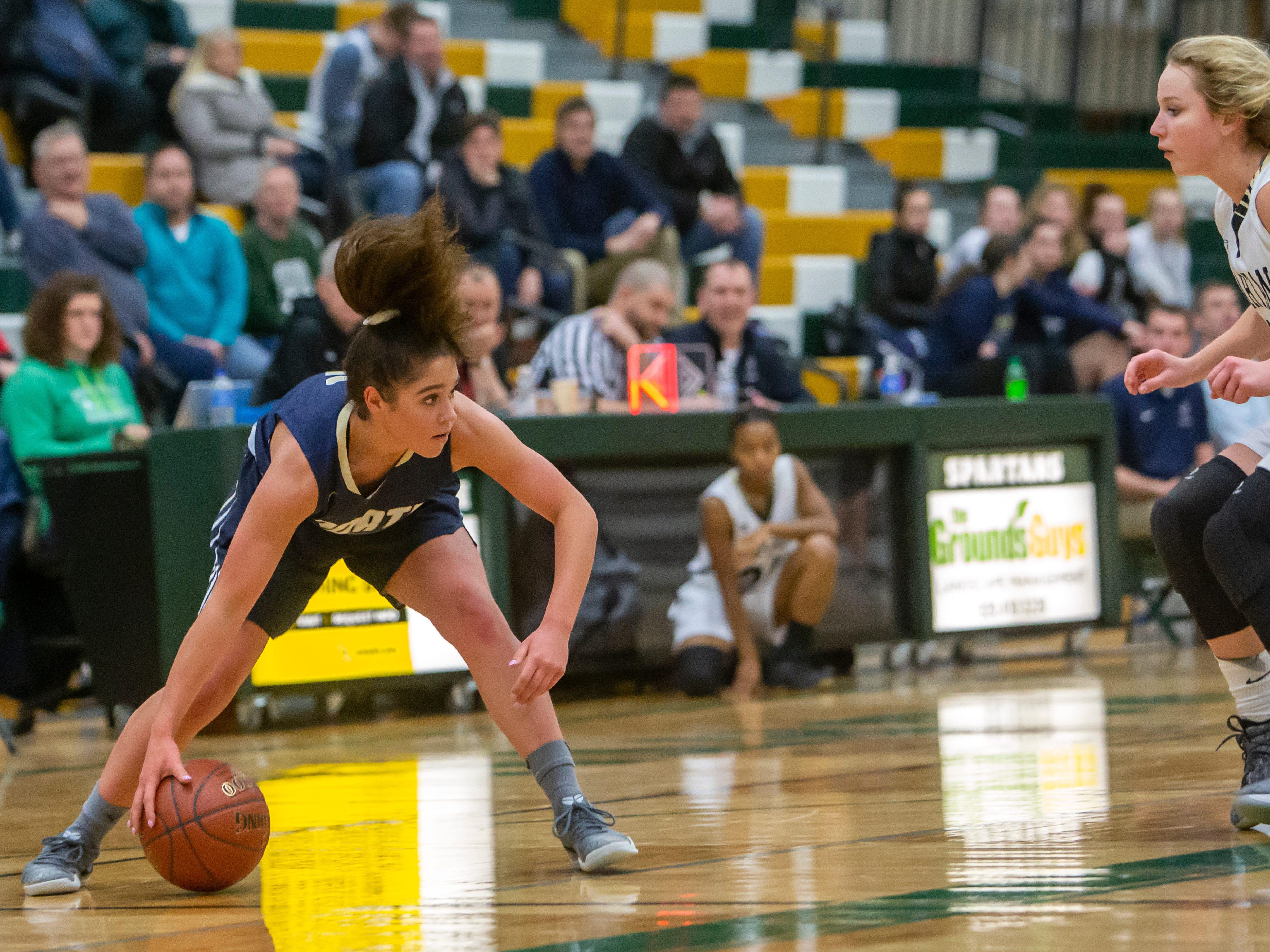 Appleton North's Niki Van Wyk picks up the loose ball during Friday's girls basketball game against Oshkosh North, February 8, 2019, in Oshkosh, Wis., at Oshkosh North High School.