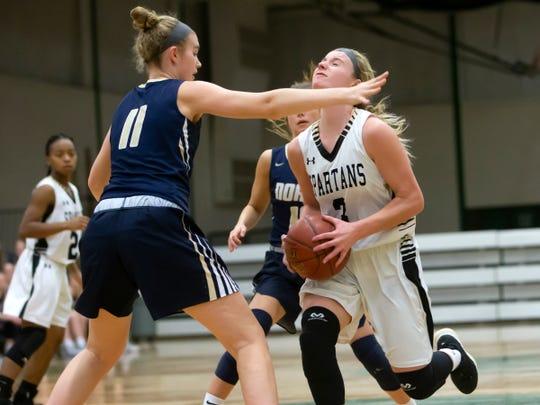 Appleton North's Emma Erickson blocks Ashley Wissink of Oshkosh North during a girls basketball game Friday in Oshkosh.