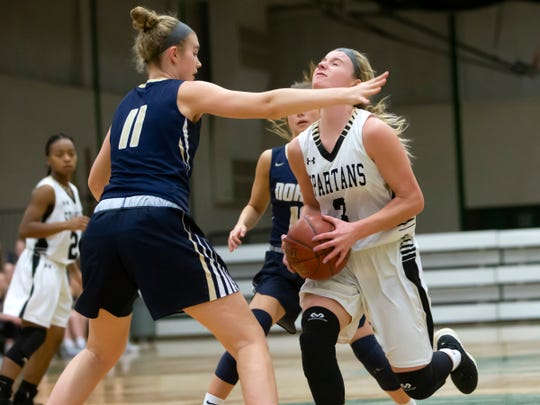 Appleton North's Emma Erickson blocks Ashley Wissink of Oshkosh North during a girls basketball game Friday in Oshkosh.