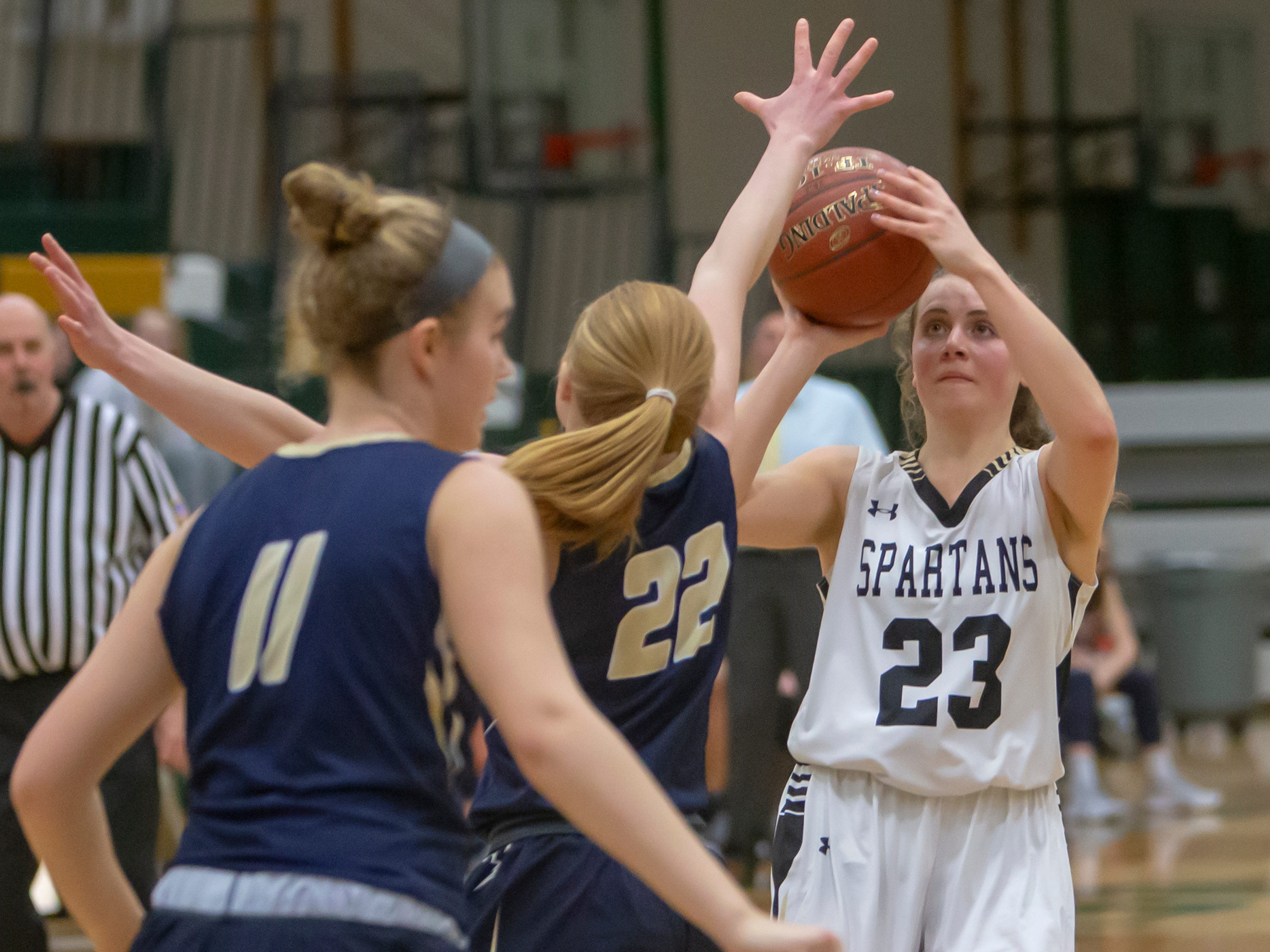 Oshkosh North's Elle Lieder shoots over Appleton North's Kayla Schroeder during a girls basketball game Friday, February 8, 2019, in Oshkosh, Wis., at Oshkosh North High School.