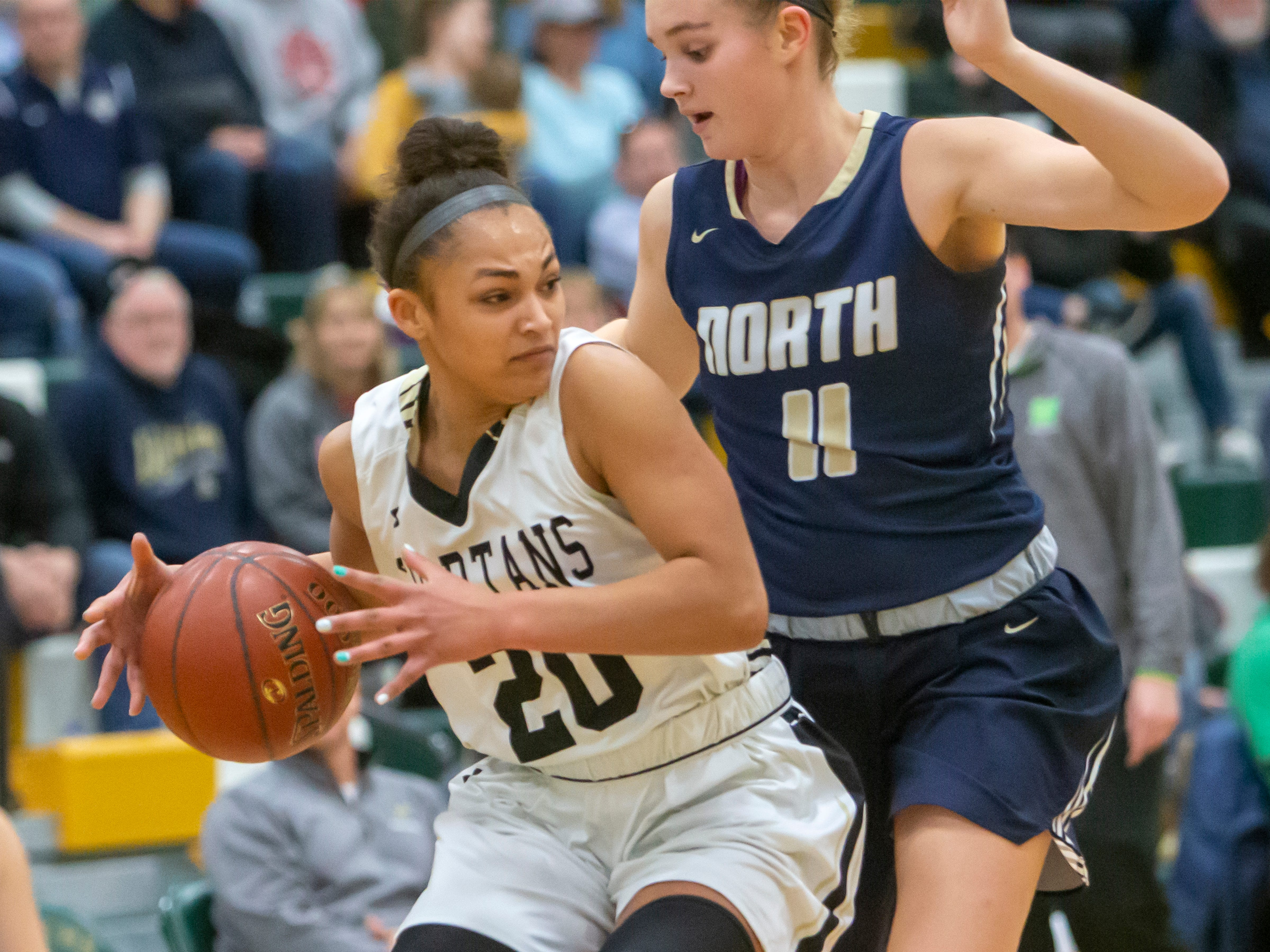 Oshkosh North's Saiga Turner protects control of the ball against Appleton North during the girls basketball game Friday, February 8, 2019, in Oshkosh, Wis., at Oshkosh North High School.