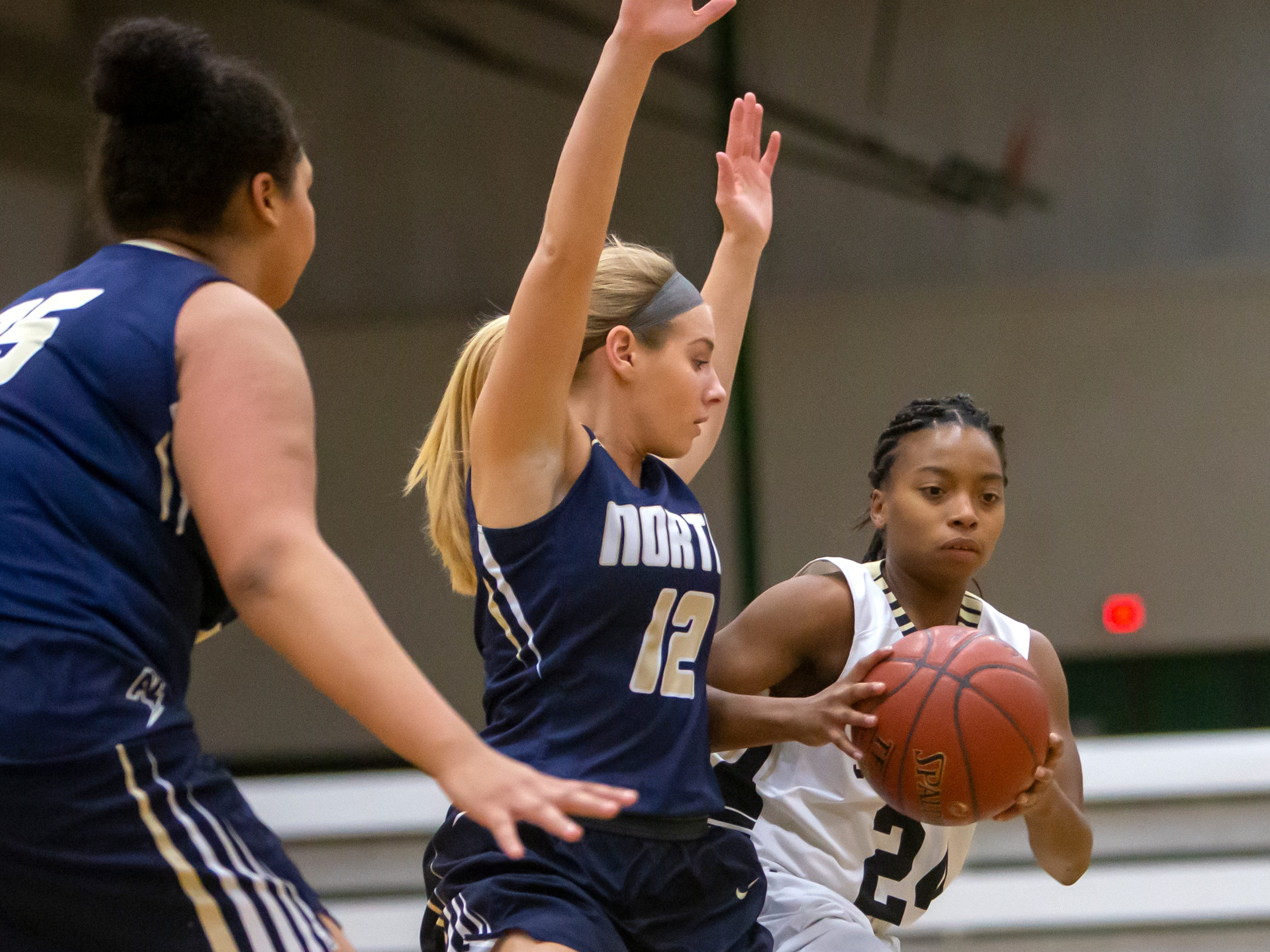 Appleton North's Teagan Prusinski attempts to stop the forward move by Oshkosh North's Nydia Griffin during the girls basketball Friday game, February 8, 2019, in Oshkosh, Wis., at Oshkosh North High School.