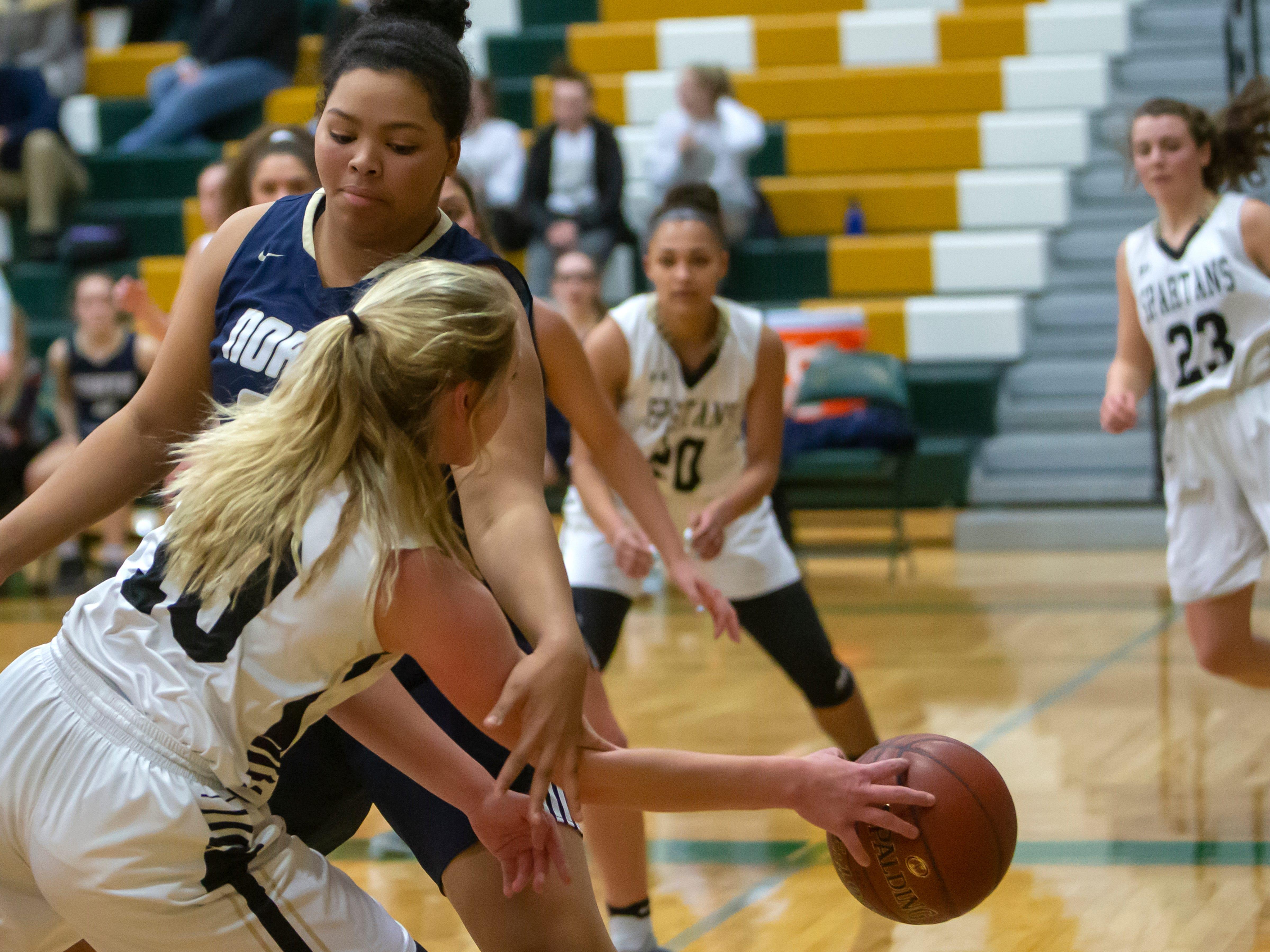 Appleton North's Makayla White attempts to block a pass by Oshkosh North's Brooke Ellestad at a girls basketball game Friday, February 8, 2019, in Oshkosh, Wis., at Oshkosh North High School.
