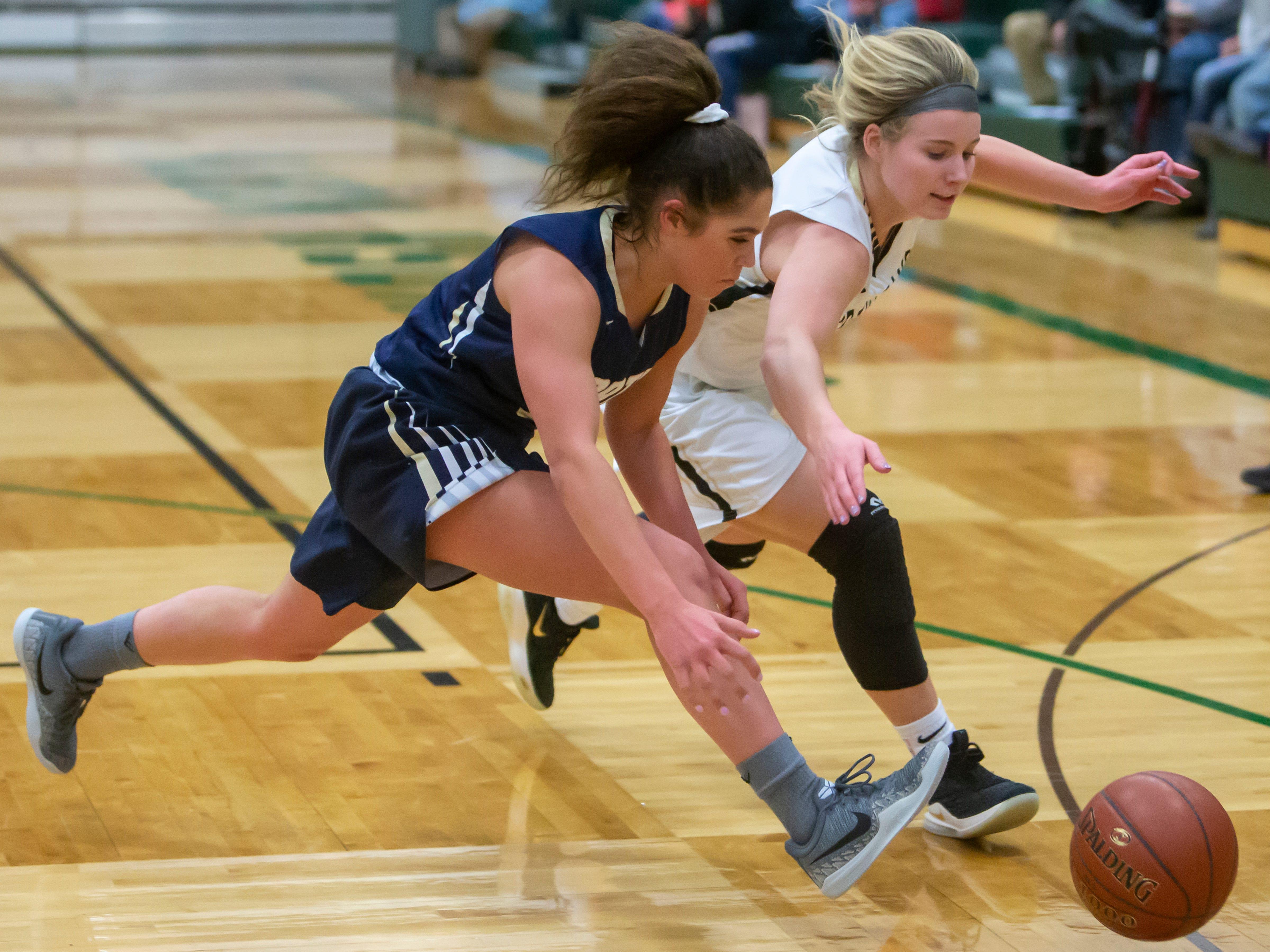 Appleton North's Niki Van Wyk and Oshkosh North's Ashley Wissink runs after the loose ball during the girls basketball game Friday, February 8, 2019, in Oshkosh, Wis., at Oshkosh North High School.